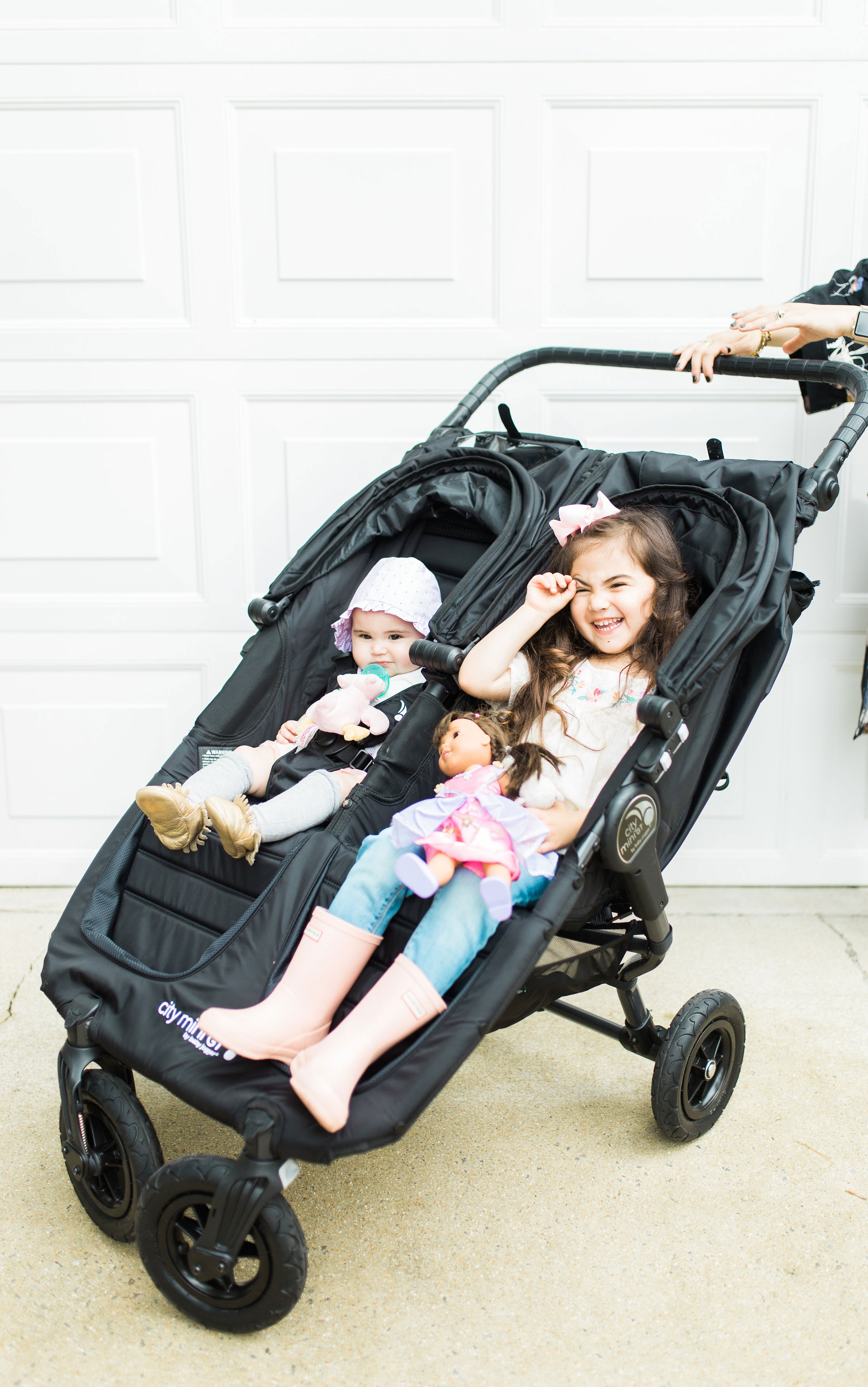Mom blogger Lexi of Glitter, Inc. reviews the Baby Jogger City Mini GT Double Stroller; and how to decide on the right double stroller for a growing family. #babyjogger #doublestroller #doublestrollerreview #strollerreview #travelsystem #babyjoggercitymini #babyjoggerreview #babyjoggercityminireview Click through for the details. | glitterinc.com | @glitterinc