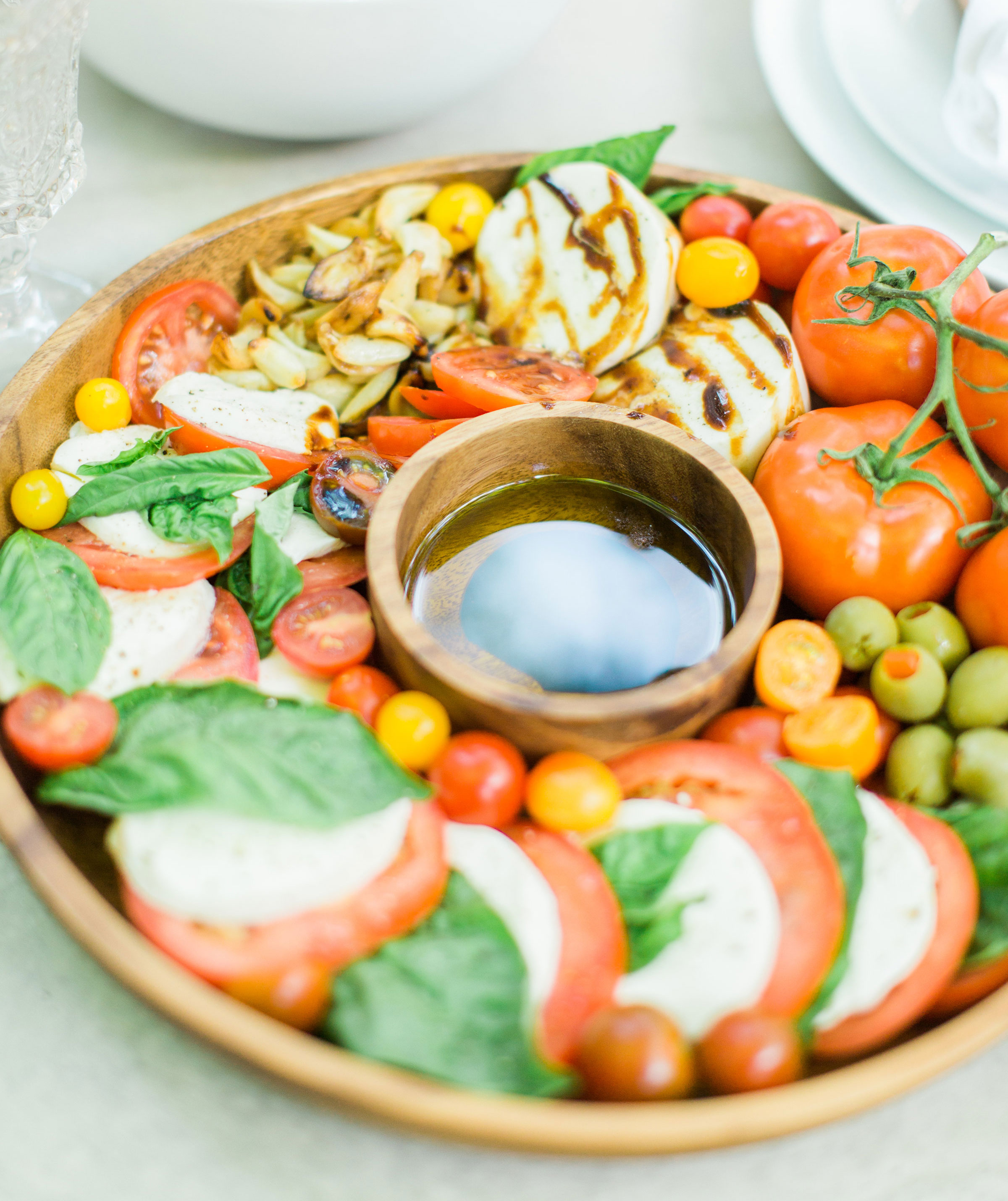 Tomatoes, fresh mozzarella, and basil drizzled with balsamic vinegar, or a sweet balsamic reduction, and olive oil; a caprese salad platter is so easy to make, looks beautiful and impressive (hello, wow factor!), and the magical combination of flavors is totally delicious. Click through for the recipe. #caprese #capresesalad #capresesaladplatter #appetizer #salad #partyfood #recipe #capreserecipe | glitterinc.com | @glitterinc