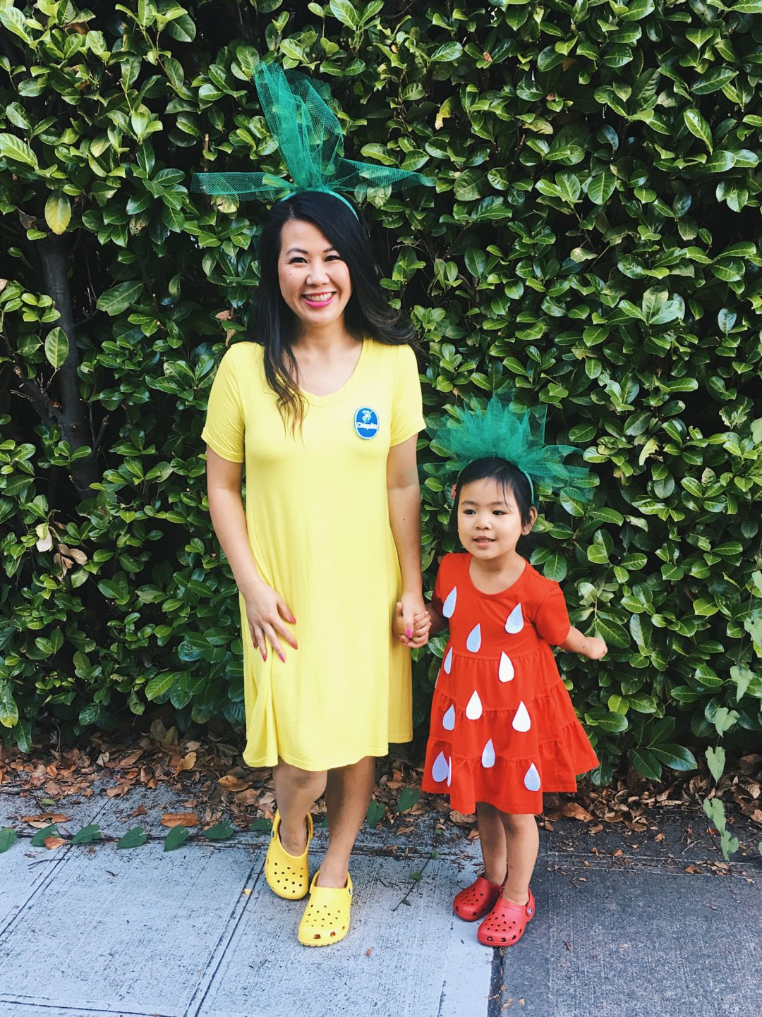 10 Adorably Awesome Halloween Costumes for Family, Kids, and Babies, including these DIY Mommy and Me Strawberry and Banana Halloween Costumes. Click through for plenty of fun DIY costumes for families. #halloween #halloweencostumeideas #familyhalloweencostume #familyhalloweencostumeideas | glitterinc.com | @glitterinc