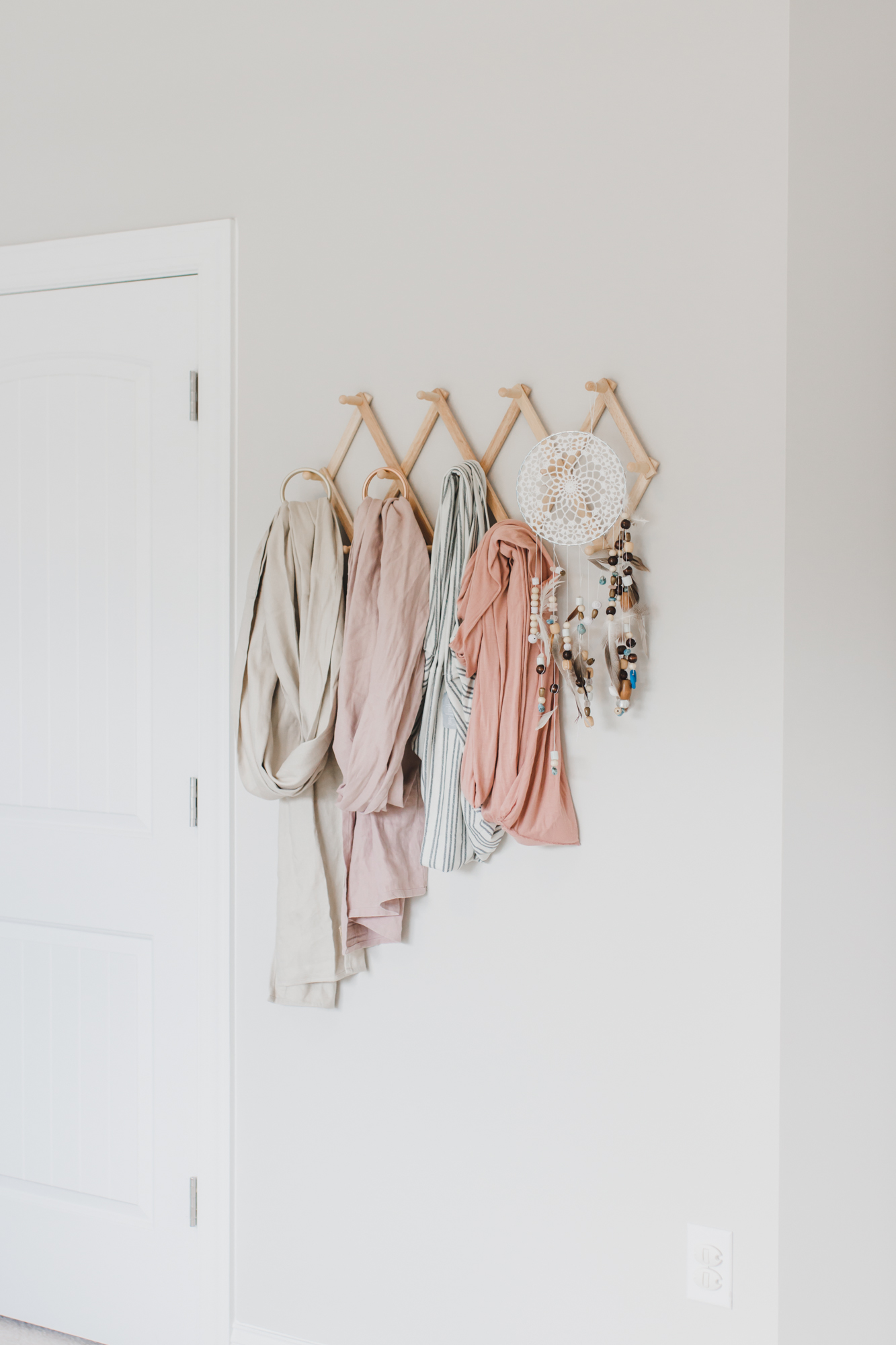 Step inside this gorgeous baby girl's nursery in soft blue and blush tones. Click through for the details. #nursery #babygirl #girlsroom #girlsnursery #girlnursery #girlroom #baby #newbaby | glitterinc.com | @glitterinc