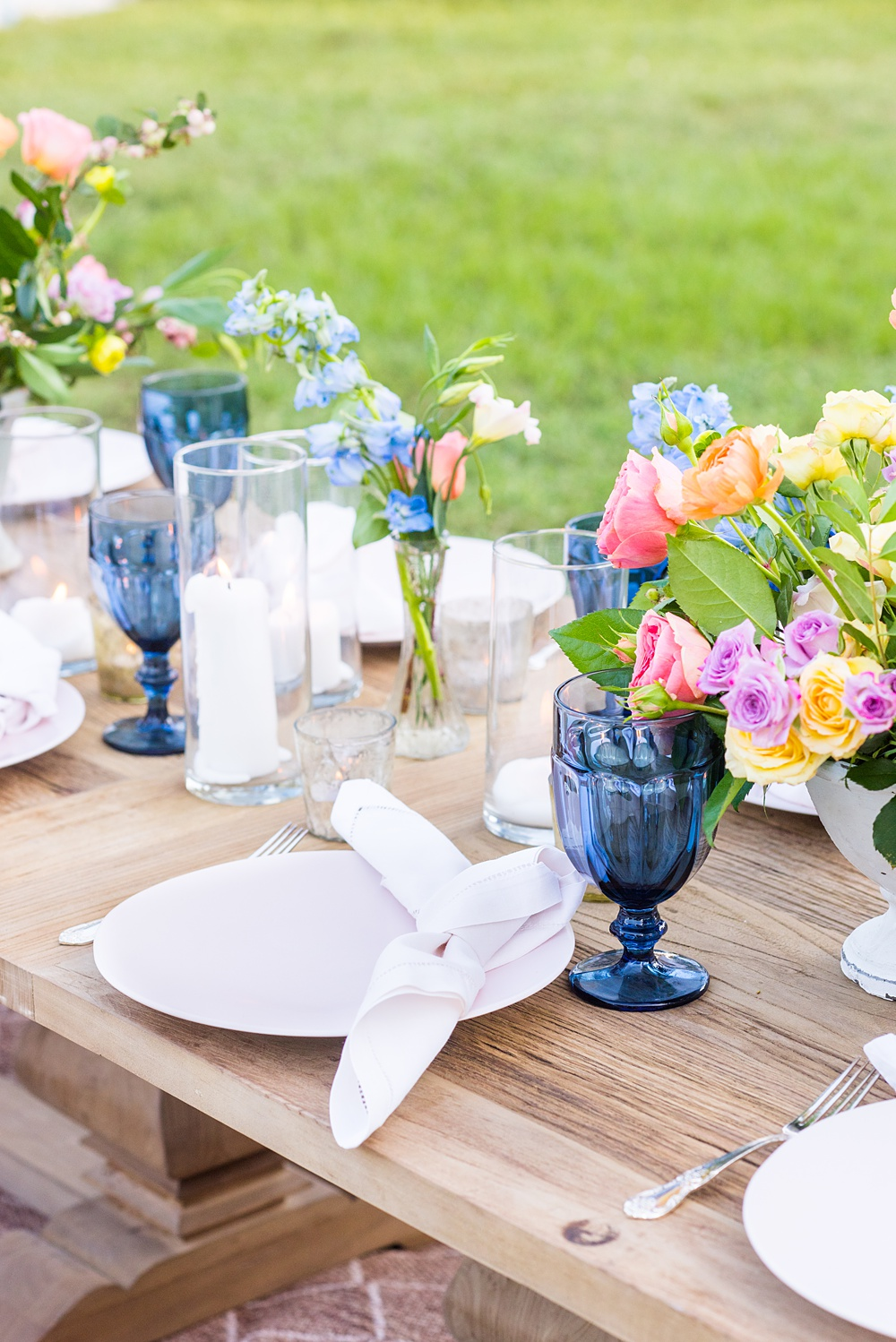Step inside this colorful outdoor bohemian thirtieth birthday party. Full of color, lush garden flowers, #gardenparty #birthdayparty #bohemianparty #unicornparty #styledshoot #backyardparty #flowers | glitterinc.com | @glitterinc