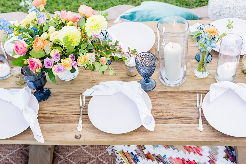 Step inside this colorful outdoor bohemian thirtieth birthday party. Full of color, lush garden flowers, and the yummiest vegan unicorn confetti cakes you ever did find! Click through for the details. Mikkel Paige Photography #gardenparty #birthdayparty #bohemianparty #unicornparty #styledshoot #flowers | glitterinc.com | @glitterinc