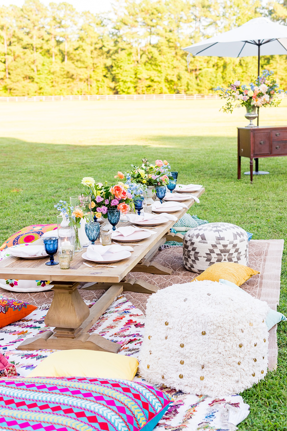 Step inside this colorful outdoor bohemian thirtieth birthday party. Full of color, and the yummiest vegan unicorn confetti cakes you ever did find! Click through for the details. Mikkel Paige Photography #gardenparty #birthdayparty #bohemianparty #unicornparty #styledshoot #backyardparty #flowers | glitterinc.com | @glitterinc