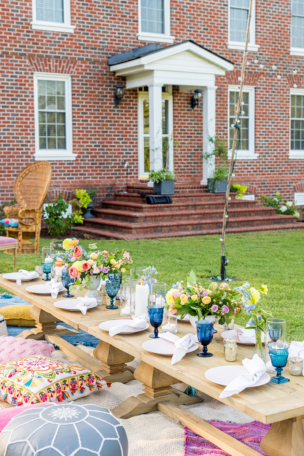 Step inside this colorful outdoor bohemian thirtieth birthday party. Full of color, lush garden flowers, and the yummiest vegan unicorn confetti cakes you ever did find! Mikkel Paige Photography #gardenparty #birthdayparty #bohemianparty #unicornparty #styledshoot #backyardparty #flowers | glitterinc.com | @glitterinc