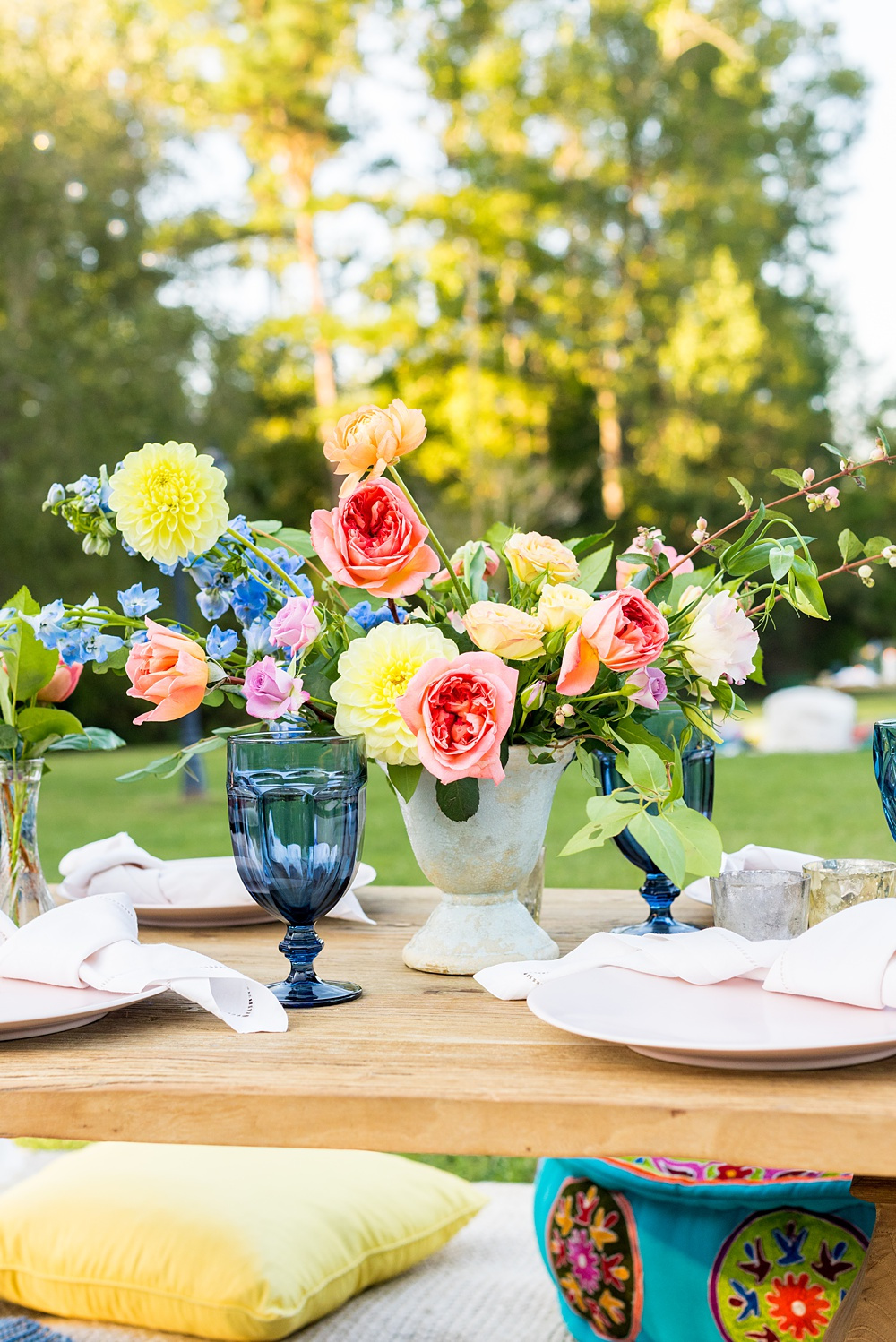 Step inside this colorful outdoor bohemian thirtieth birthday party. Full of color, lush garden flowers, and the yummiest vegan unicorn confetti cakes you ever did find! Click through for the details. Mikkel Paige Photography #gardenparty #birthdayparty #bohemianparty #unicornparty #styledshoot #backyardparty #flowers | glitterinc.com
