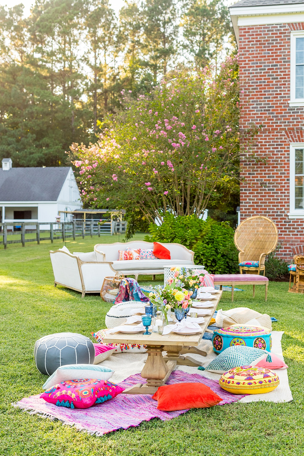 Step inside this colorful outdoor bohemian thirtieth birthday party. Full of color, lush garden flowers, and the yummiest vegan unicorn confetti cakes you ever did find! Click through for the details. Mikkel Paige Photography #gardenparty #birthdayparty #bohemianparty #unicornparty #styledshoot #backyardparty #flowers | glitterinc.com | @glitterinc