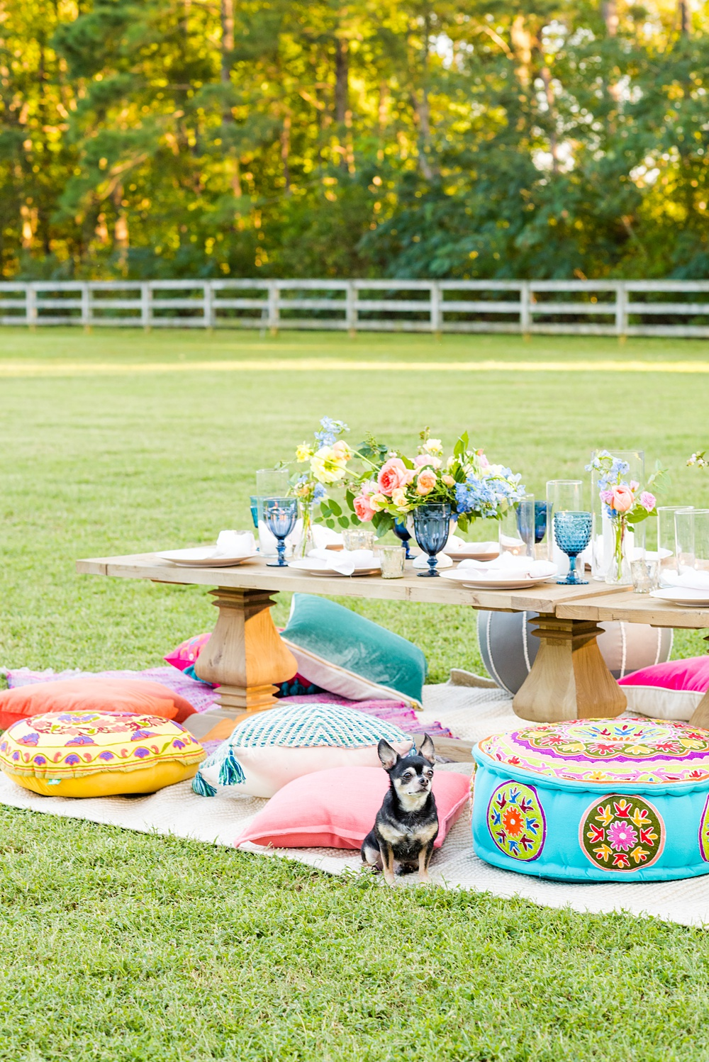Step inside this colorful outdoor bohemian thirtieth birthday party. Full of color, lush garden flowers, and the yummiest vegan unicorn confetti cakes you ever did find! Click through for the details. Mikkel Paige Photography #gardenparty #birthdayparty #bohemianparty #styledshoot #backyardparty #flowers | glitterinc.com | @glitterinc