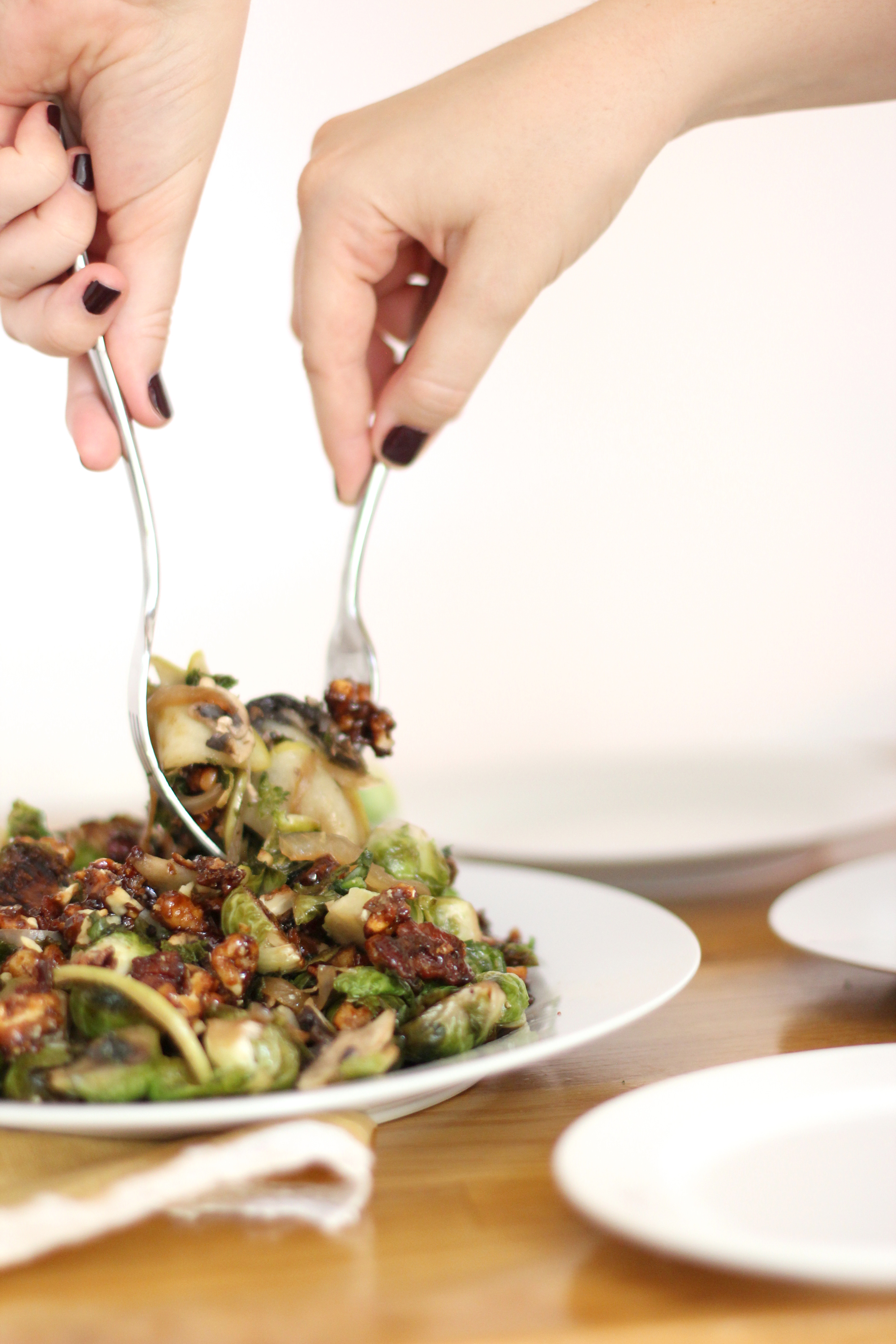 Brussels Sprouts with Candied Bacon and Walnuts - This one is a total crowd-pleaser; plus more than 125+ incredible fall recipes that everyone should try. Click through for the recipes. #fallrecipe #fallrecipes #thanksgiving #thanksgivingrecipe | glitterinc.com | @glitterinc