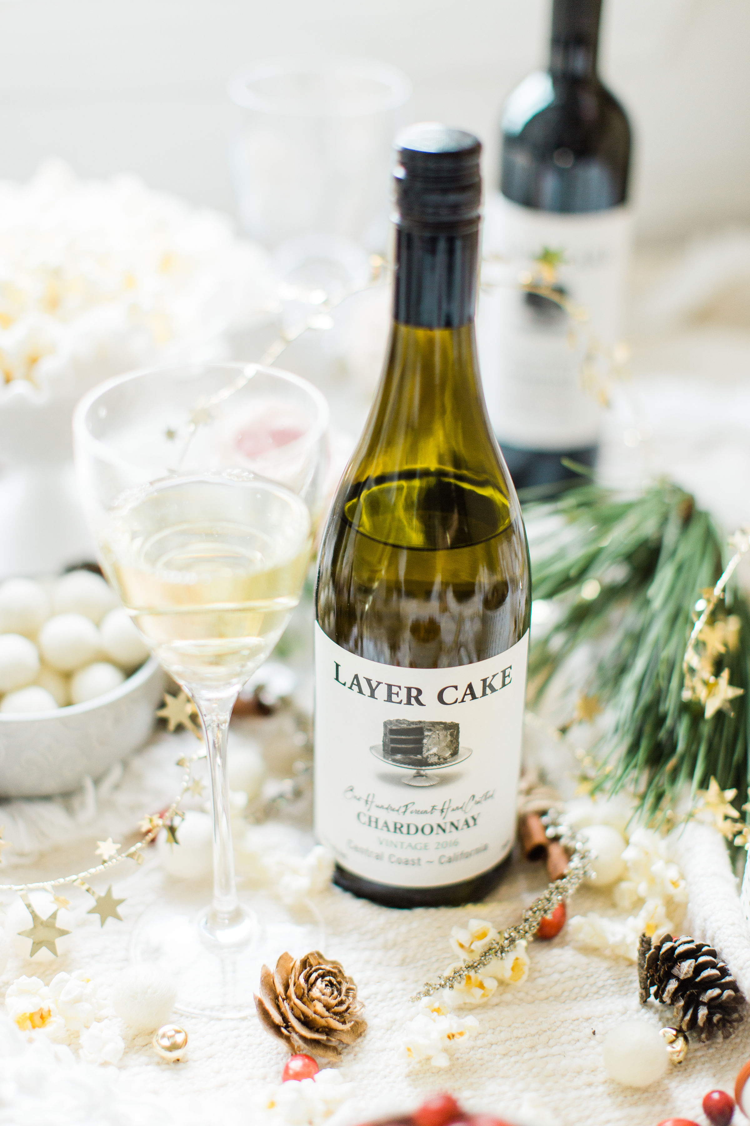Layer Cake Wine. #holidayparty #christmasparty #diychristmas #diyholidays #garland #holidaygarland #diyholidaygarland #diygarland #christmasgarland #holidaygirlsnight #christmasgirlsnight | glitterinc.com | @glitterinc