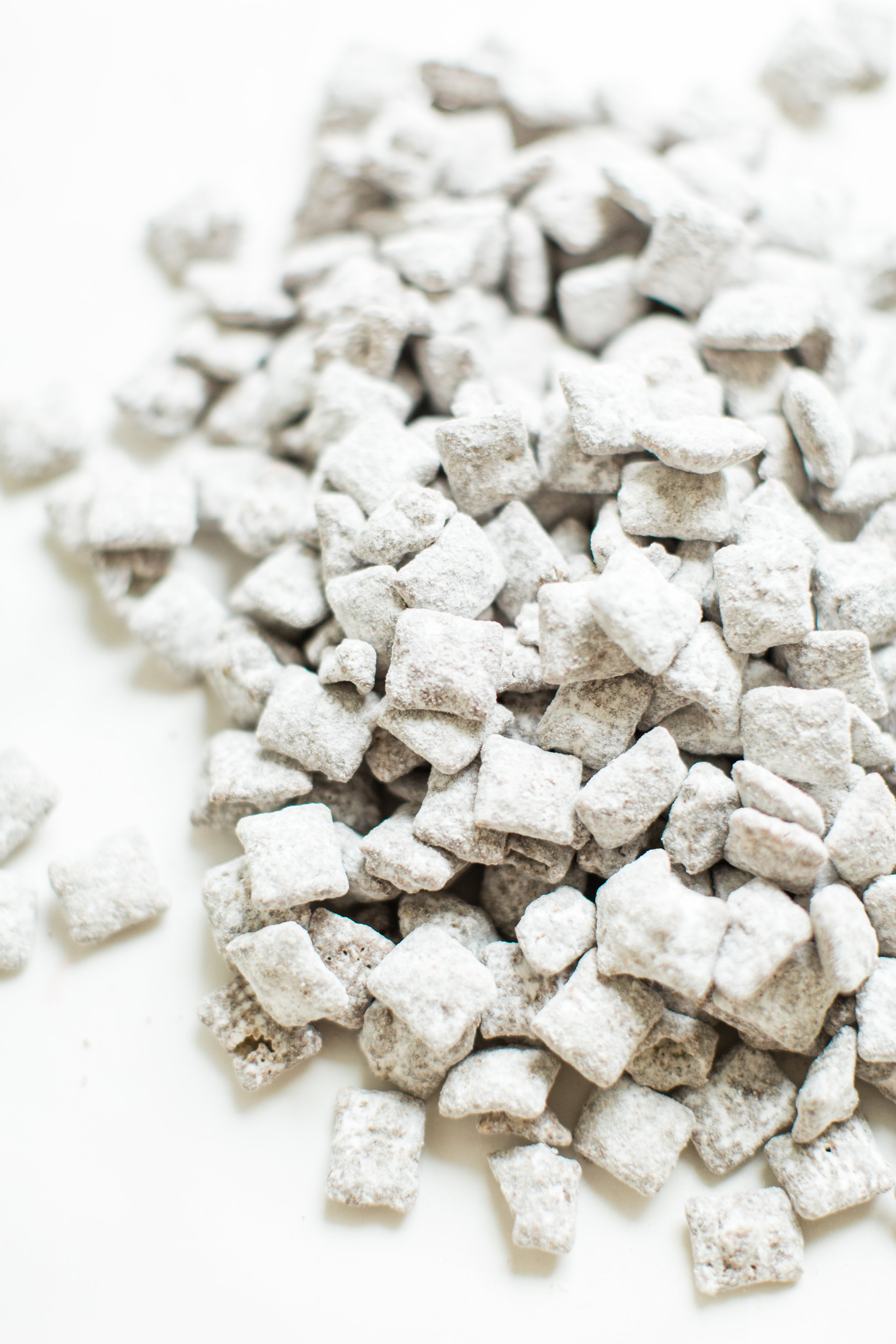 Positively addictive classic Puppy Chow Muddy Buddies - comes together in minutes, is no-bake, and can be made up in big batches - perfect for gifting! Click through for the recipe. #muddybuddies #puppychow #holidayrecipe #dairyfree #vegan #vegandessert | glitterinc.com | @glitterinc