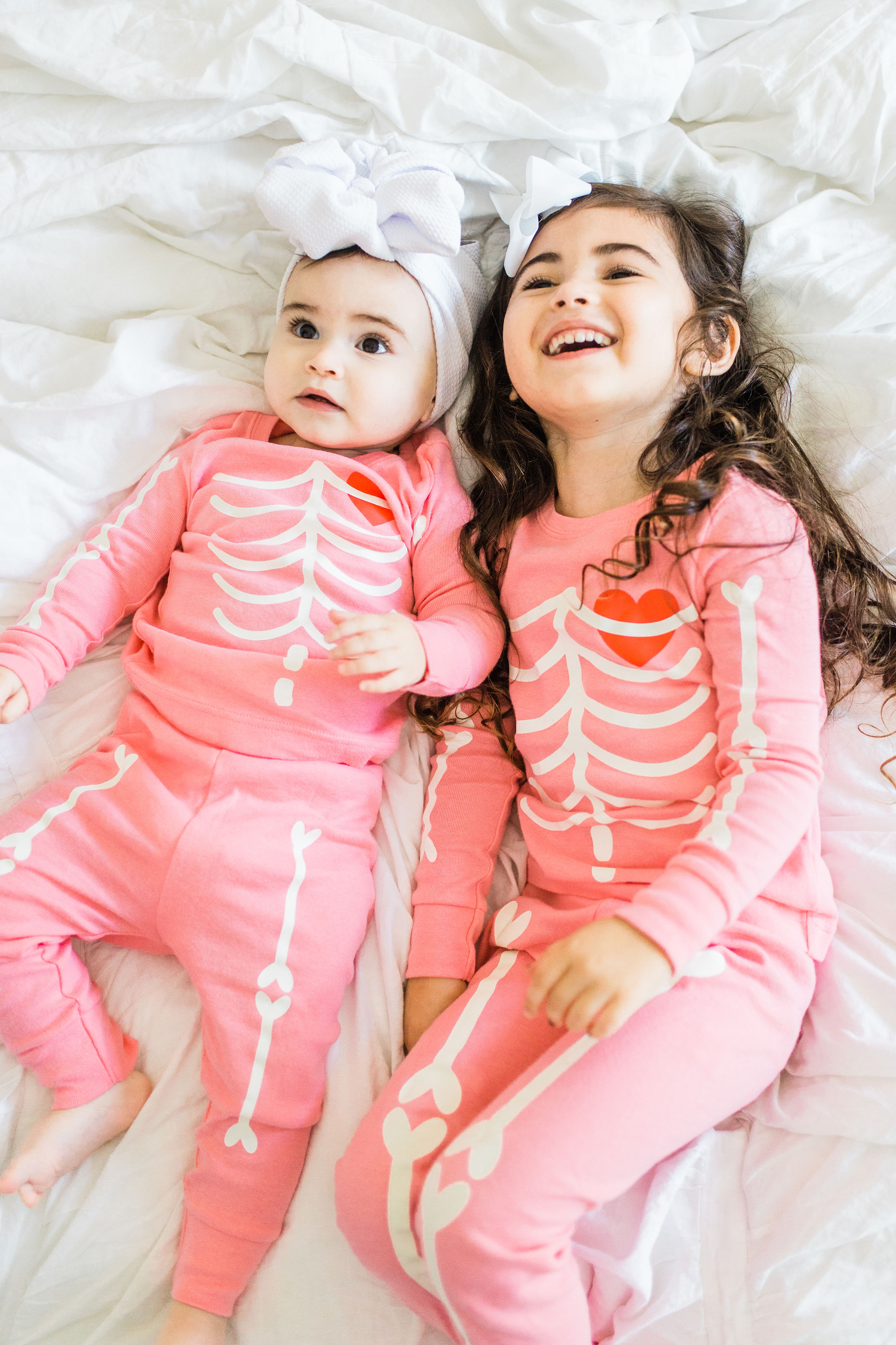 Looking to start a few fun Halloween family traditions? We're sharing our favorites, including a roundup of the best Halloween movies for kids, the cutest matching Halloween pajamas for your little ones, and plenty of spooky party inspiration and recipes! Click through for the details. #halloween #halloweenpajamas #halloweenideas #halloweentraditions #familyhalloween  #kidshalloweenfun #kidshalloweenpajamas #babyhalloween | glitterinc.com | @glitterinc