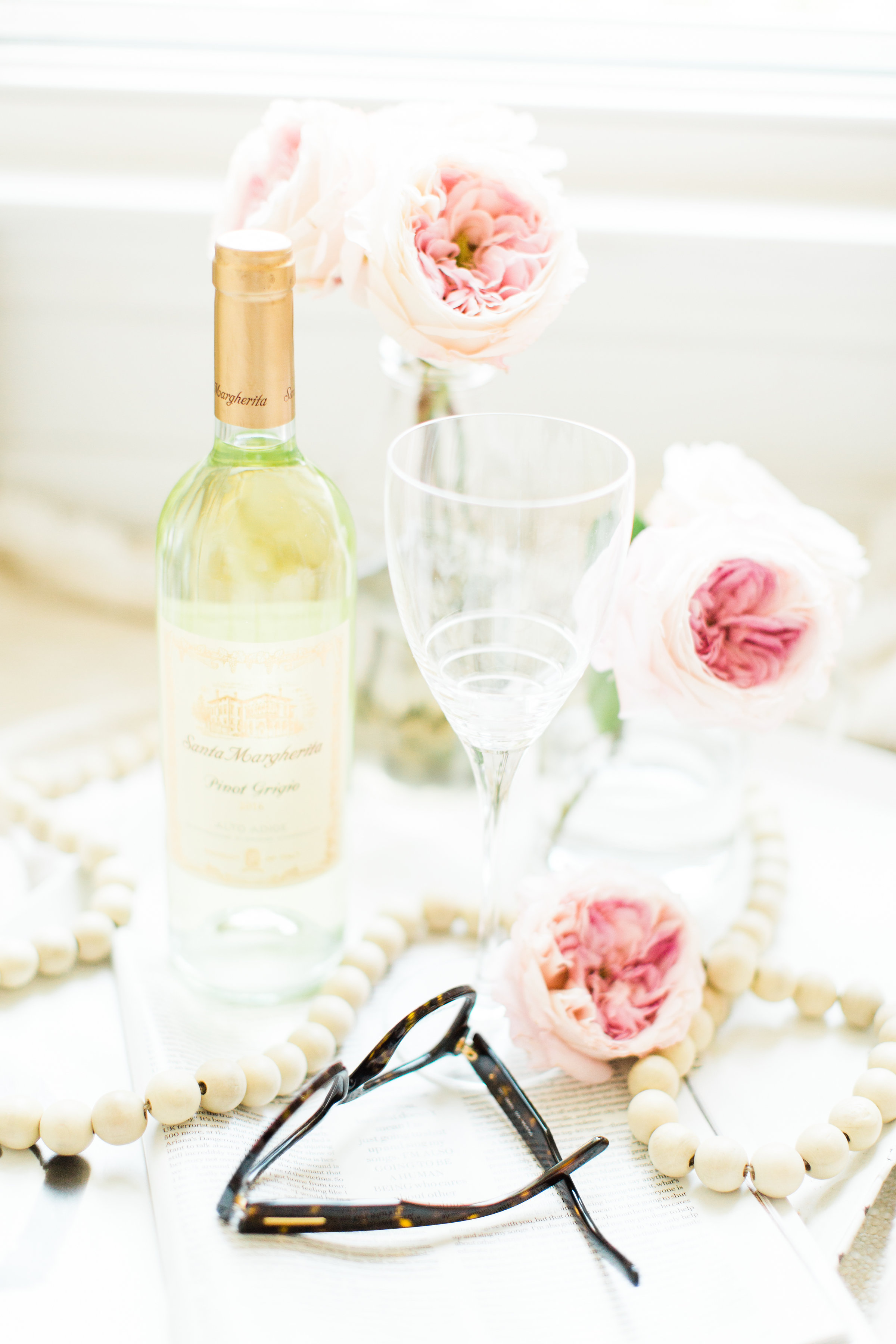 Lifestyle blogger Lexi of Glitter, Inc. shares a few little love notes to the things she loved most this week, including how to have a date night at home. #datenight #wine #glasses #roses #flowers Click through for the details. | glitterinc.com | @glitterinc