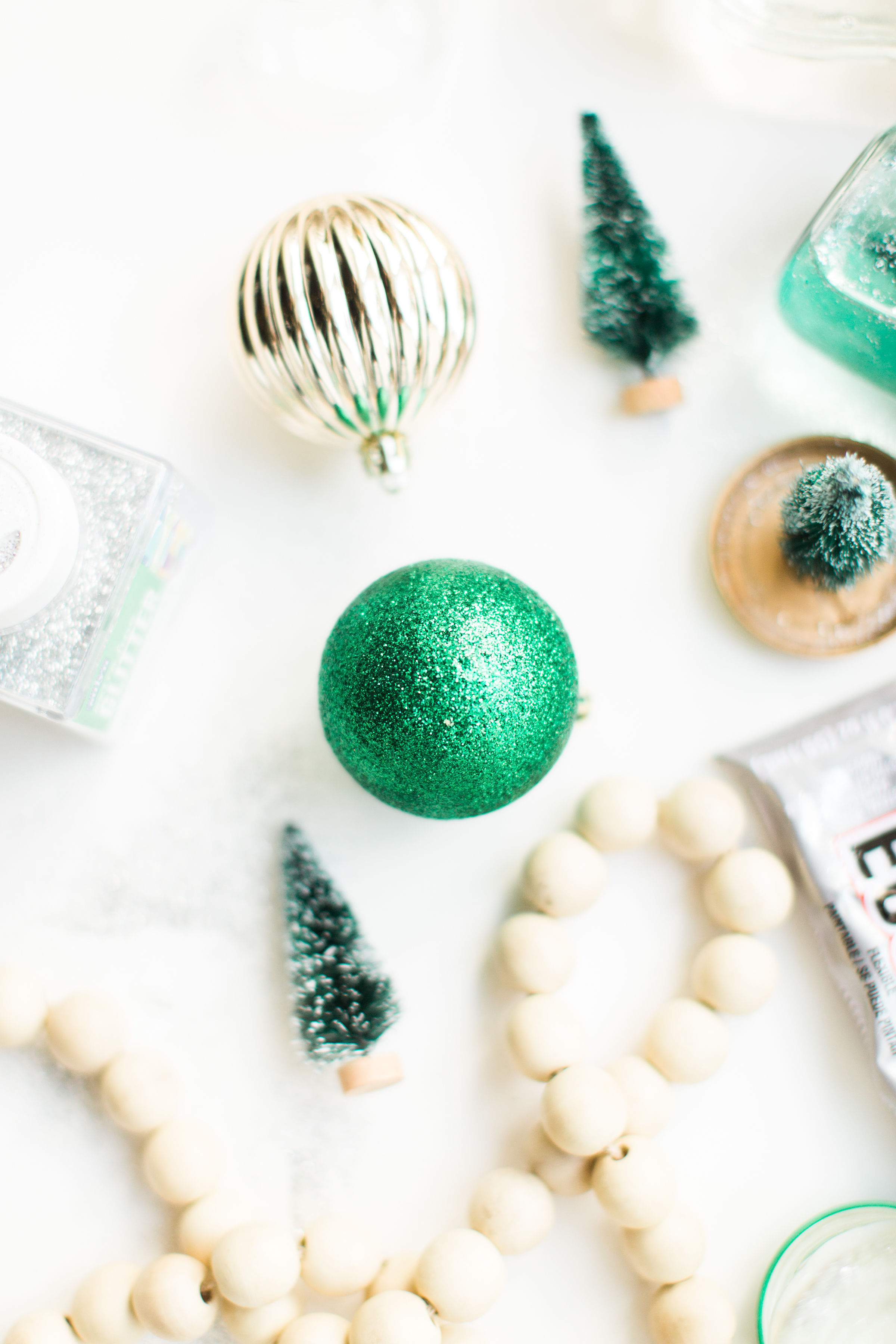 Glitter DIY snow globes are fun to make, are a great craft to do with kids, and double as a calm down sensory bottle for a little quiet time on days when the whole family is going a little stir crazy! Click through for the details. #kidsdiy #kidscraft #diysnowglobes #howtomakesnowglobes #sensorybottles #sensoryglobes #toddlercraft #wintercraft #christmas #christmasdiy  | glitterinc.com | @glitterinc