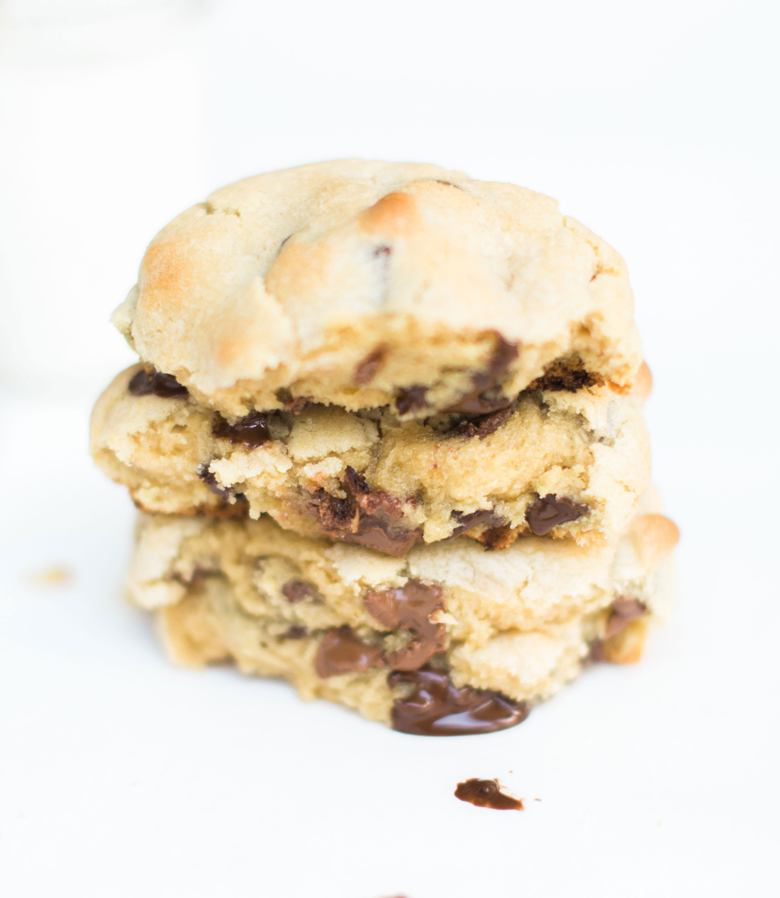 Here it is!The Famous Levain Bakery Chocolate Chip Cookie Recipe that all of New York City is obsessed with; plus a few little tweaks that had our whole family totally crushing on these. You have got to try these super thick, gooey, and decadent #cookies. Click through for the #recipe. #levainbakery #levainbakerychocolatechipcookies #levainbakerycookies #famouscookies | glitterinc.com | @glitterinc