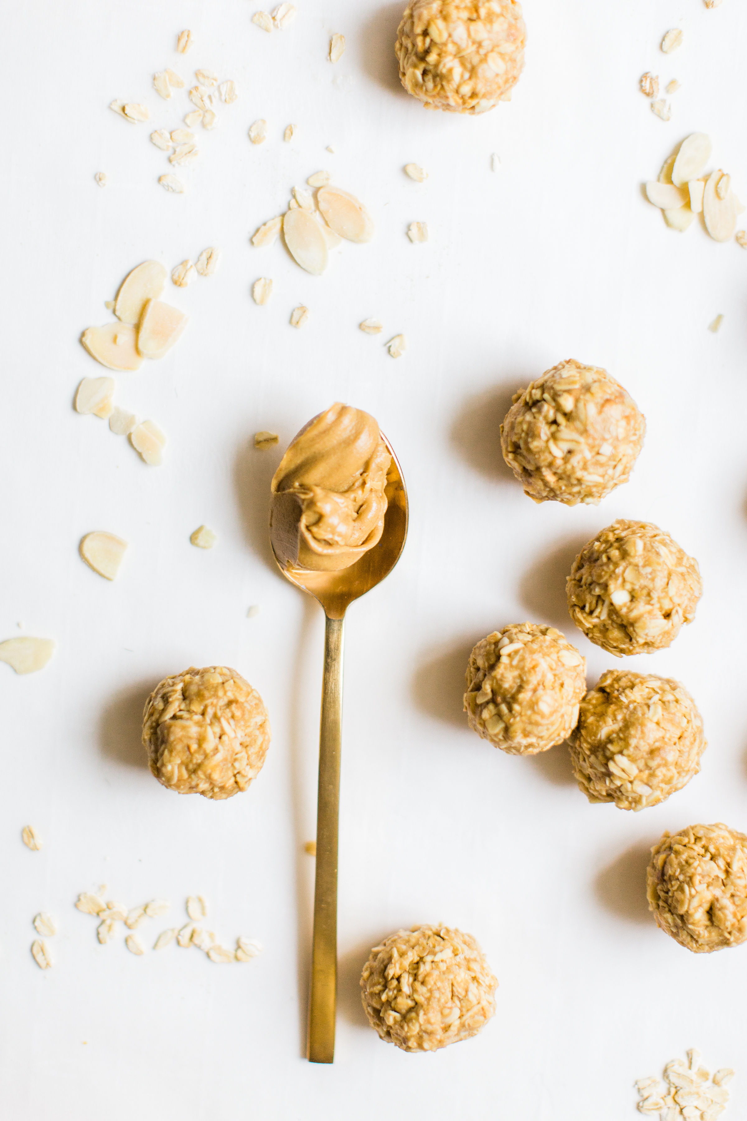 These no-bake energy bites are easy to make, the perfect combination of sweet and salty, have plenty of added protein thanks to the peanut butter, and kids absolutely love them because they're basically delicious no-bake cookies! Click through for the recipe. #snack #energybites #nobake #nobakecookies #healthysnack #kidsrecipe #kidssnack | glitterinc.com | @glitterinc