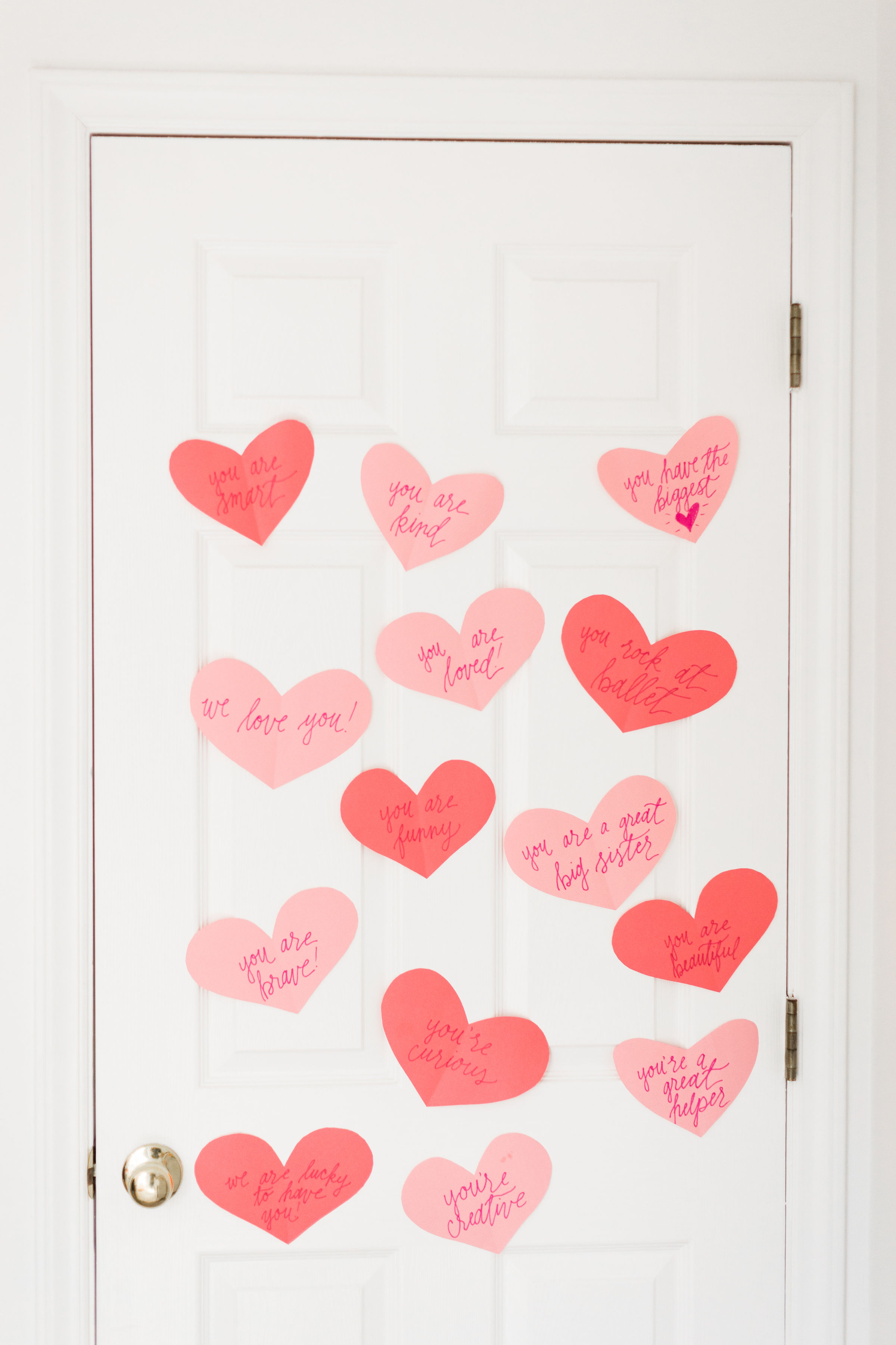 A DIY heart attack - paper hearts spelling out the reasons you love your Valentine - are sure to surprise and delight kids and grown-ups alike! | glitterinc.com | @glitterinc