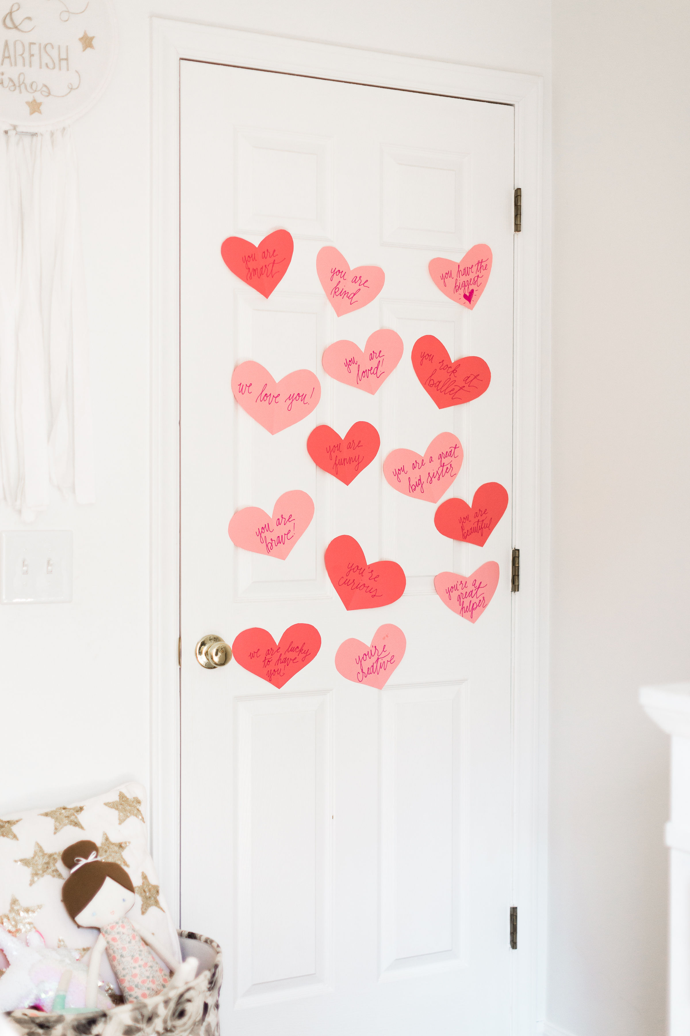 A DIY heart attack - paper hearts spelling out the reasons you love your Valentine - are sure to surprise and delight kids and grown-ups alike! | Click through for the details. | glitterinc.com | @glitterinc