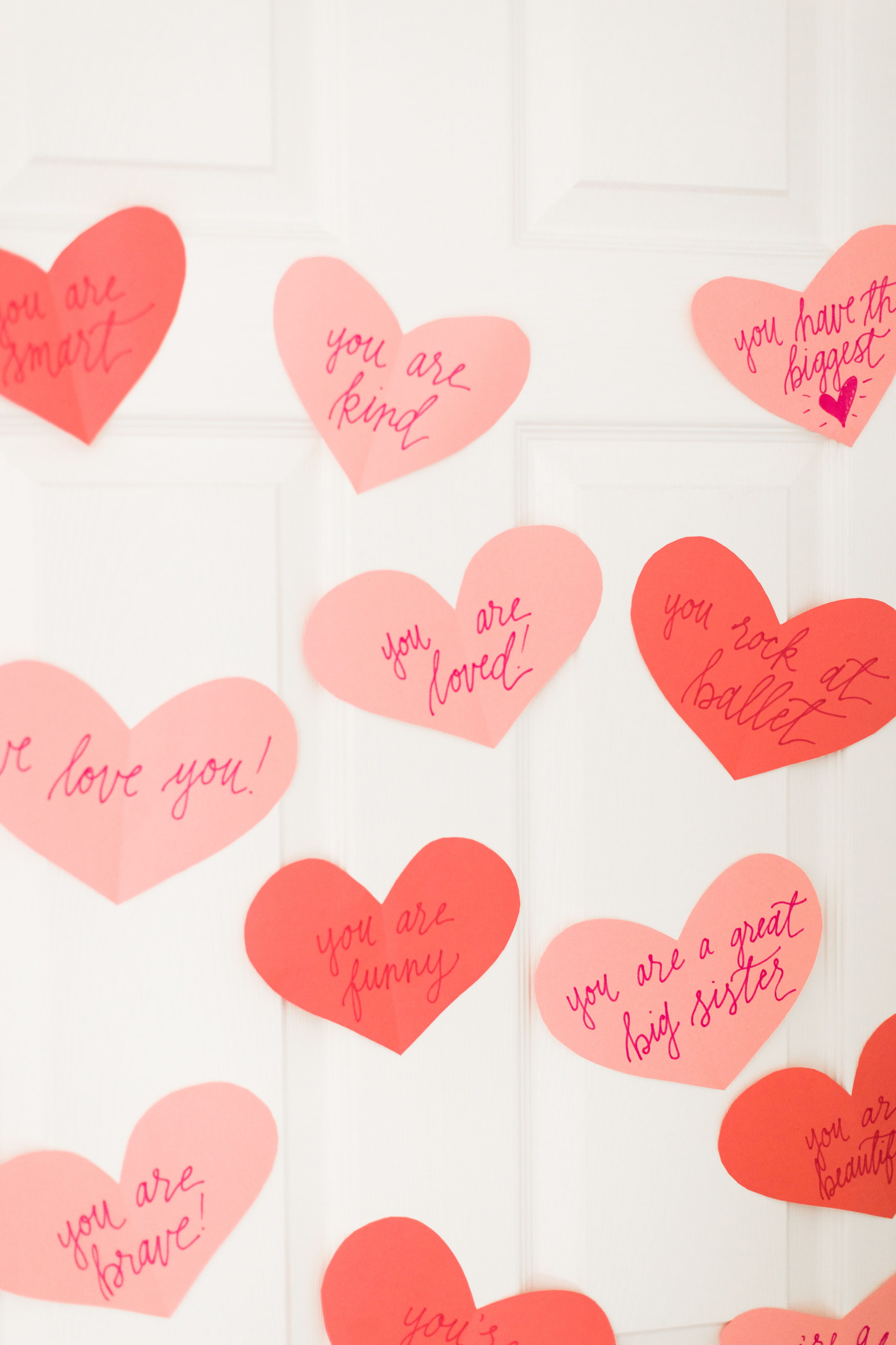 A DIY heart attack - paper hearts spelling out the reasons you love your Valentine - are sure to surprise and delight kids and grown-ups alike! | glitterinc.com