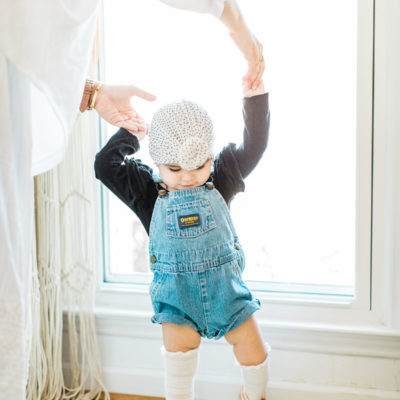 baby girl wearing overalls