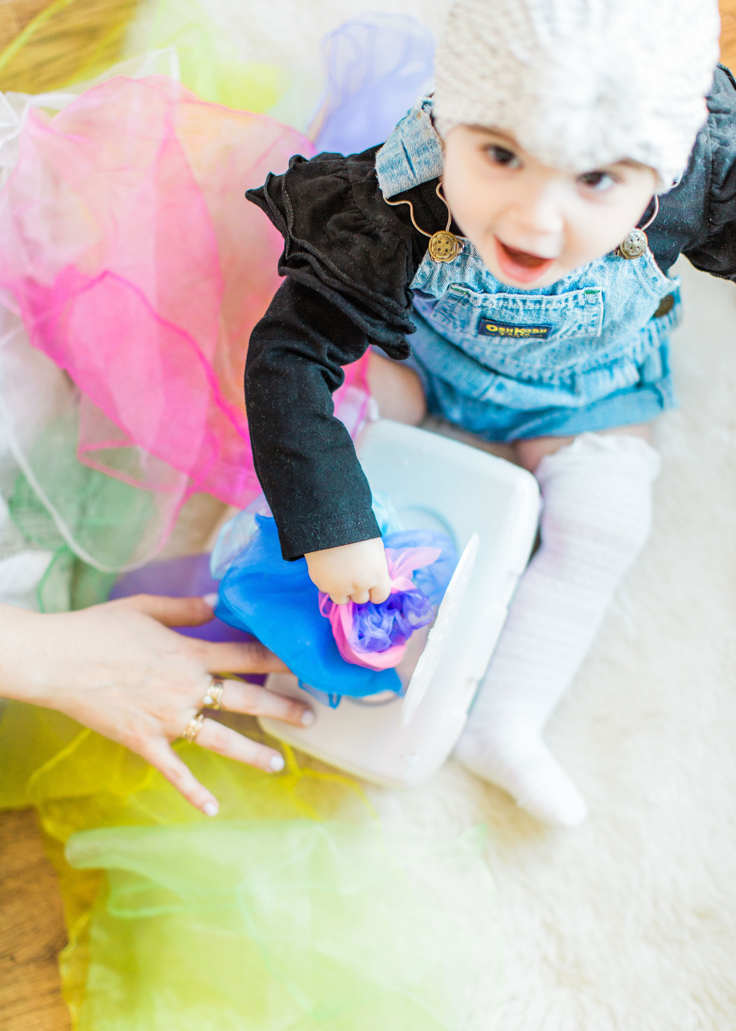 Make an easy, magic sensory toy using an empty wipes container and inexpensive colorful scarves. | Click through for the DIY. | glitterinc.com | @glitterinc