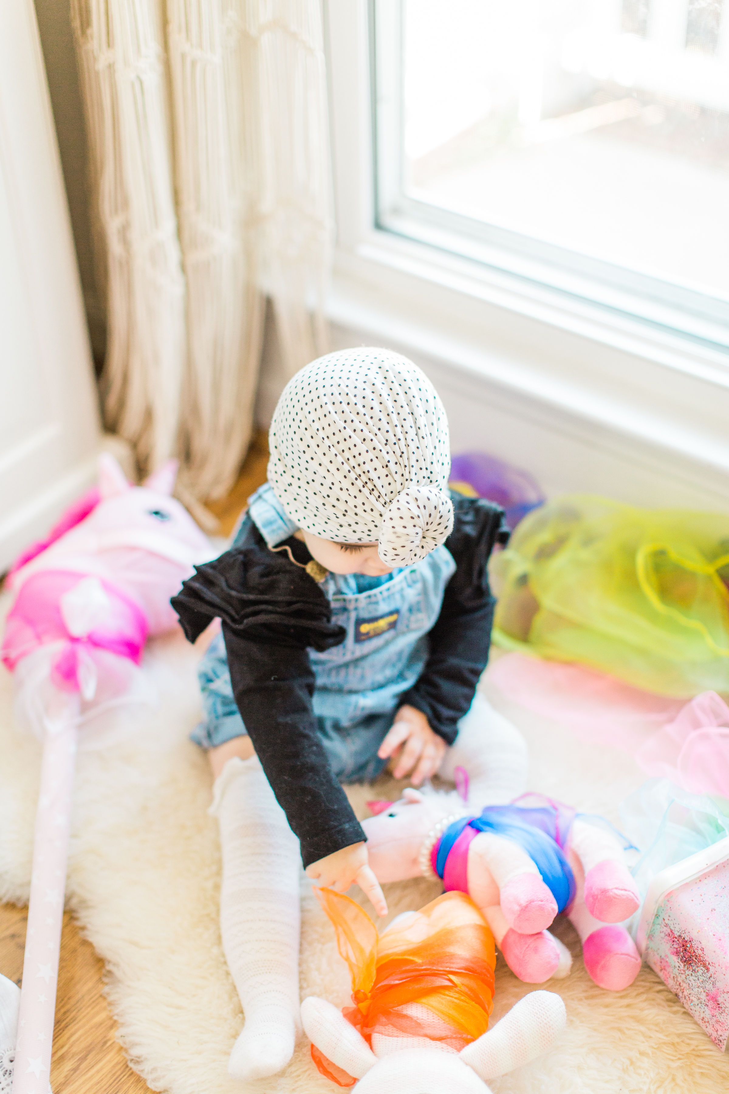 Looking for a fun activity to do with your baby? Make an easy, magic sensory toy using an empty wipes container and inexpensive colorful scarves. | Click through for the DIY. | glitterinc.com |