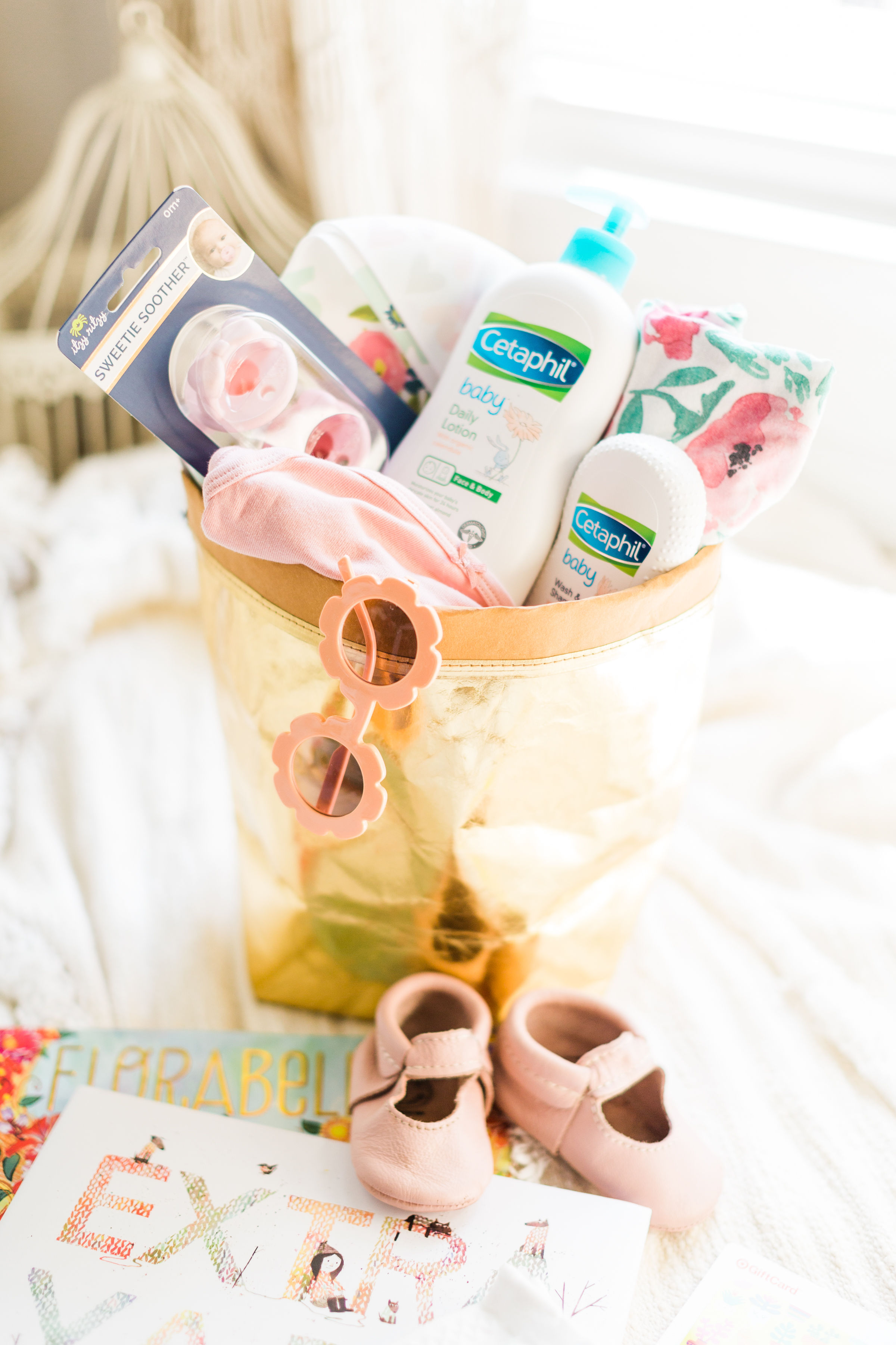 How to put together the cutest DIY baby shower gift basket that is not only memorable and sweet, but every part of the basket is super useful and functional. | Click through for the details. | glitterinc.com | @glitterinc