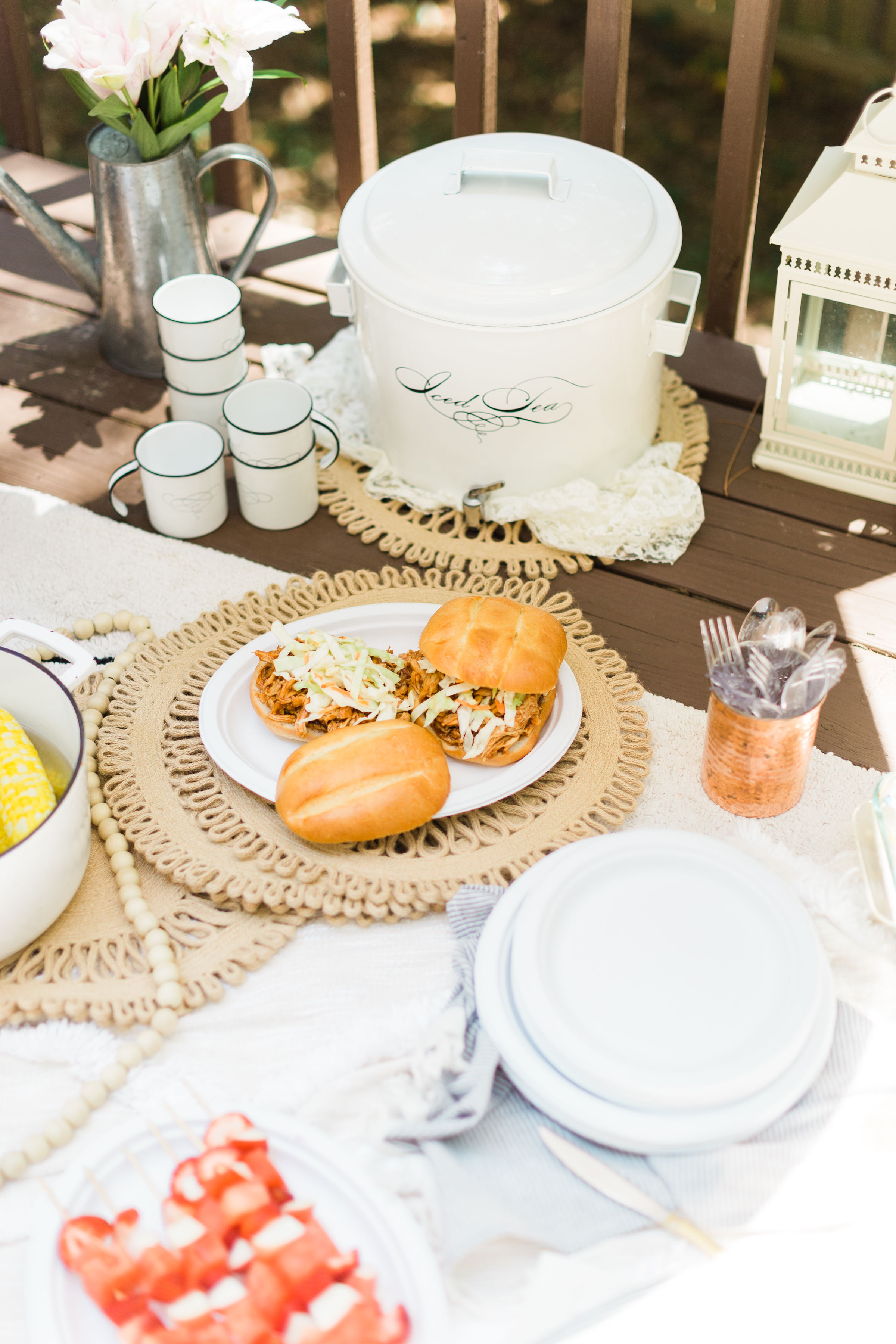 Soak up the great outdoors and serve dinner outside this summer. Here's how to throw a simple backyard BBQ picnic your whole family will love! | glitterinc.com | @glitterinc