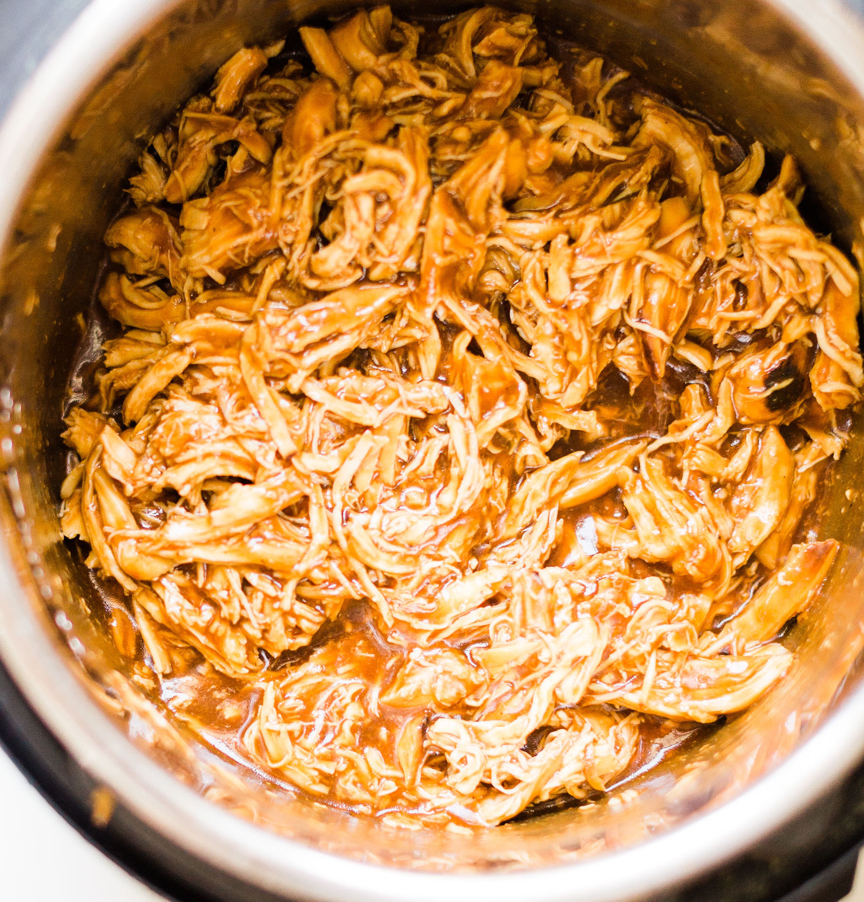 Crockpot BBQ Pulled Chicken. Yum! Click through for the BBQ recipe. | glitterinc.com | @glitterinc