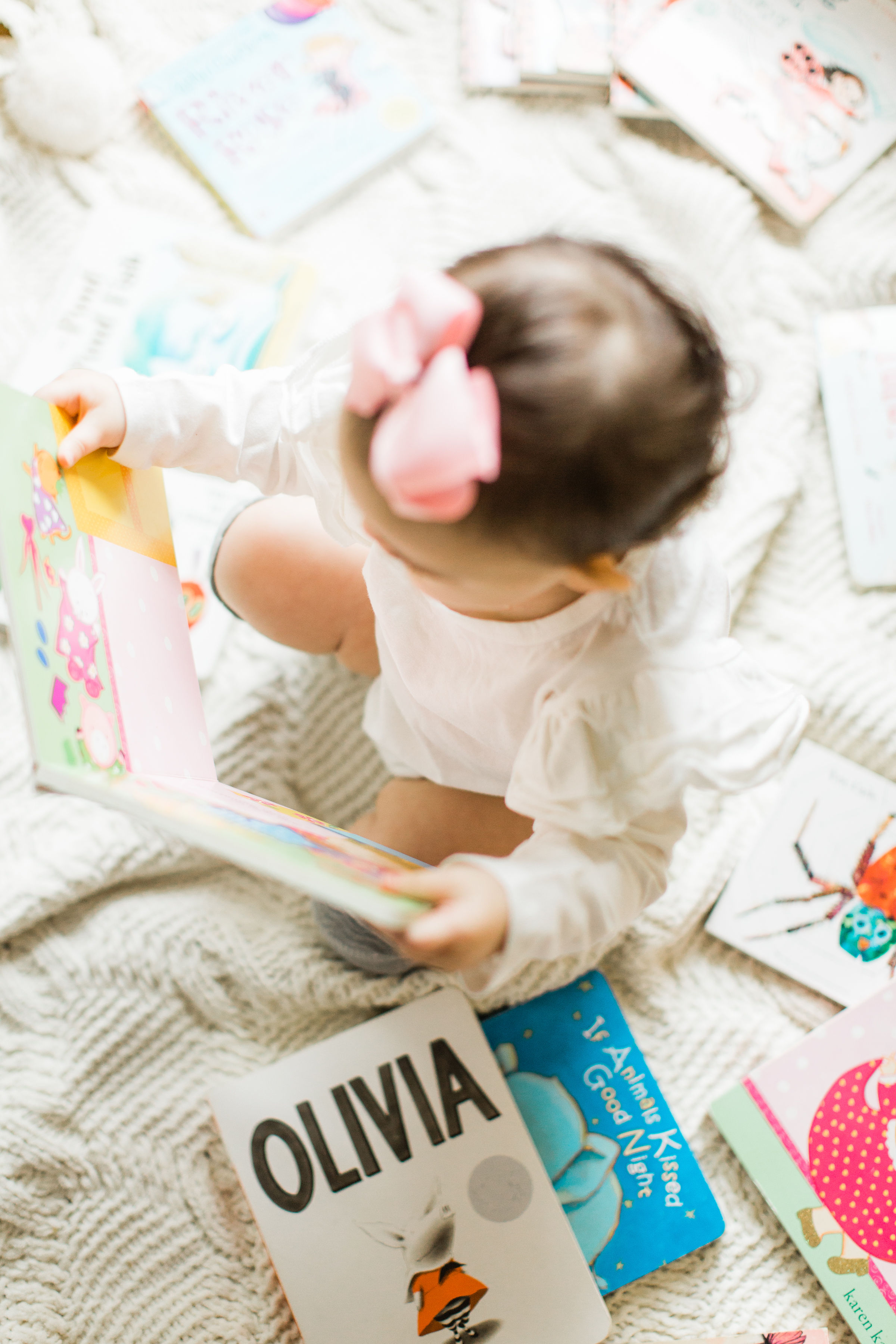 Sale on Children's Books at Amazon, baby playing with books