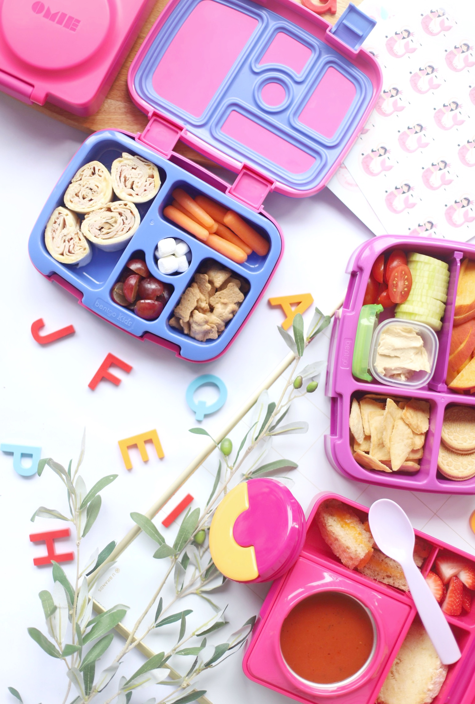 a lunch with grapes and carrots and rolls for Bento Box Lunch Ideas
