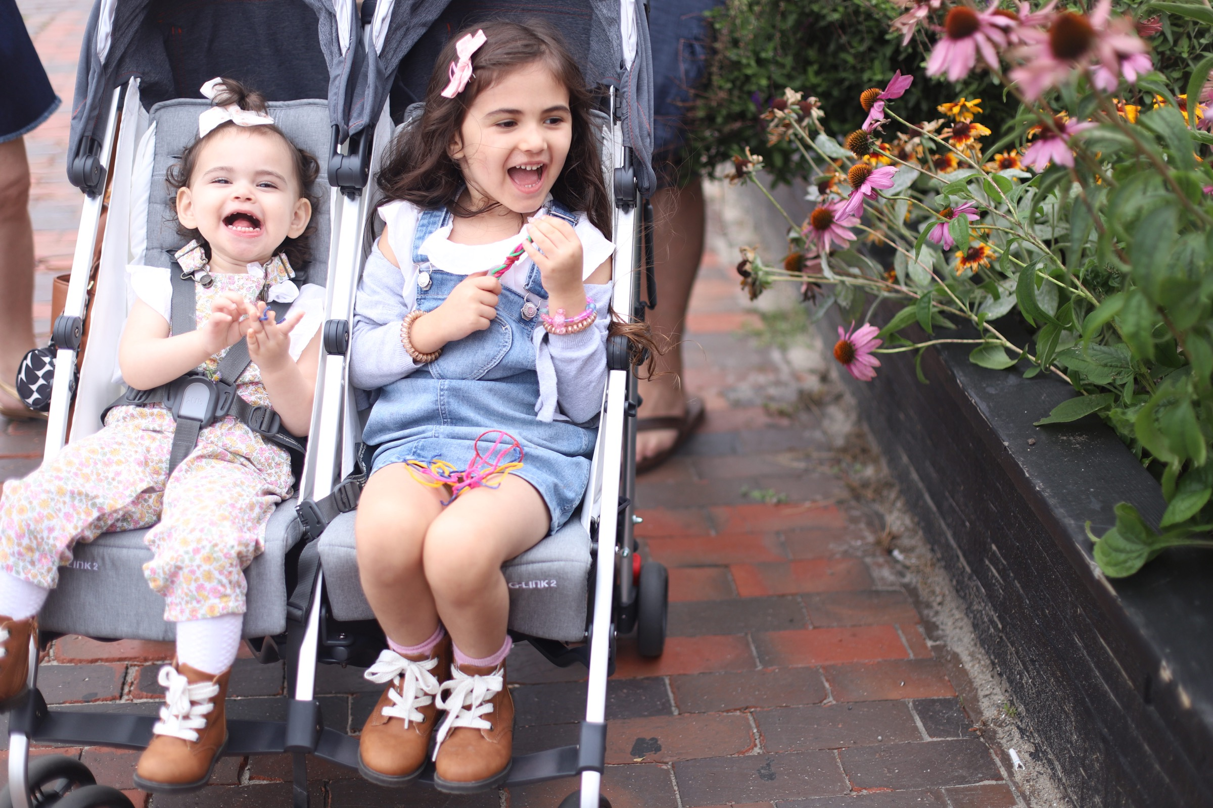 kids in a double stroller from UPPAbaby G-LINK 2 and why it's the perfect double stroller for travel with two kidsa