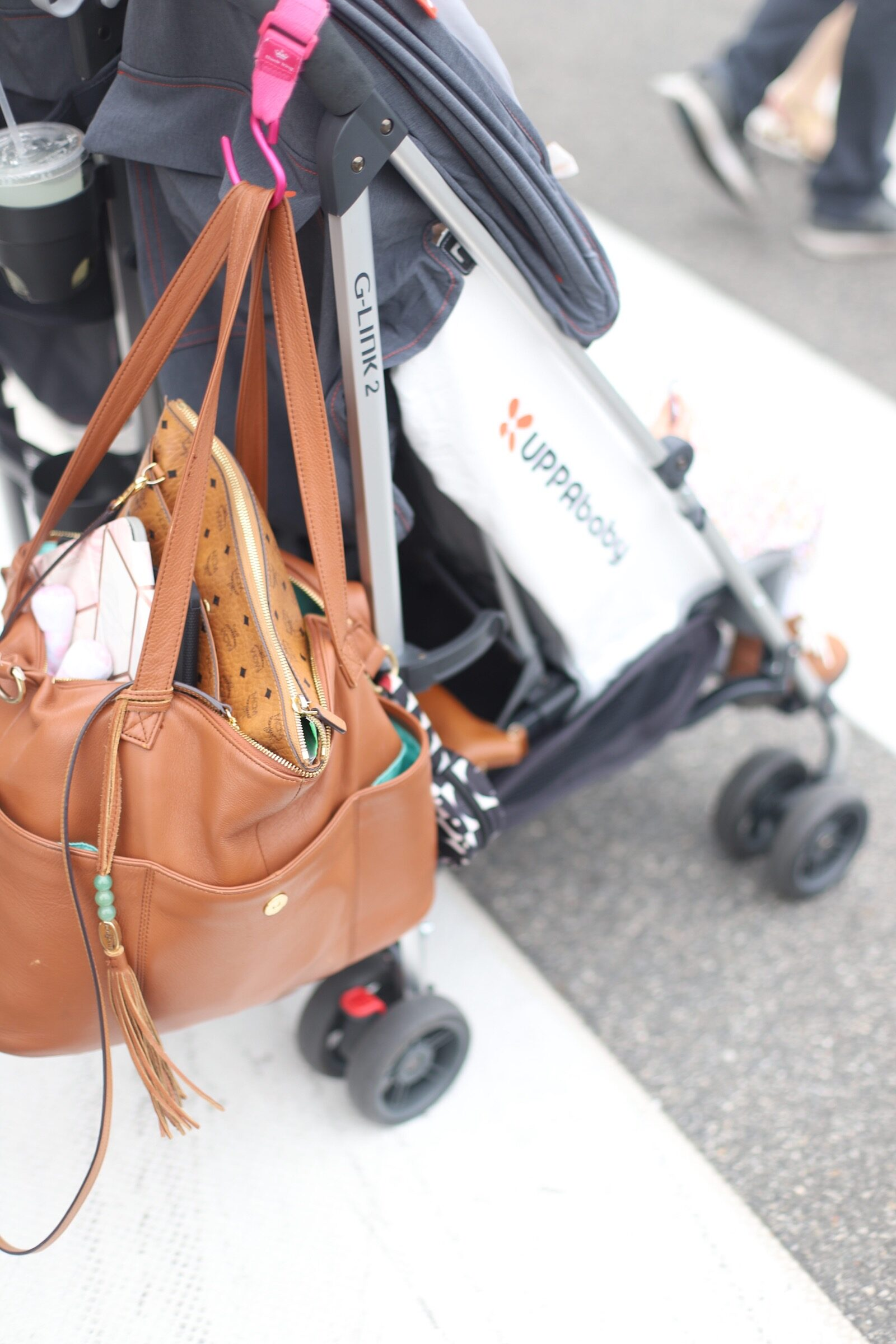 stroller with a leather bag hanging