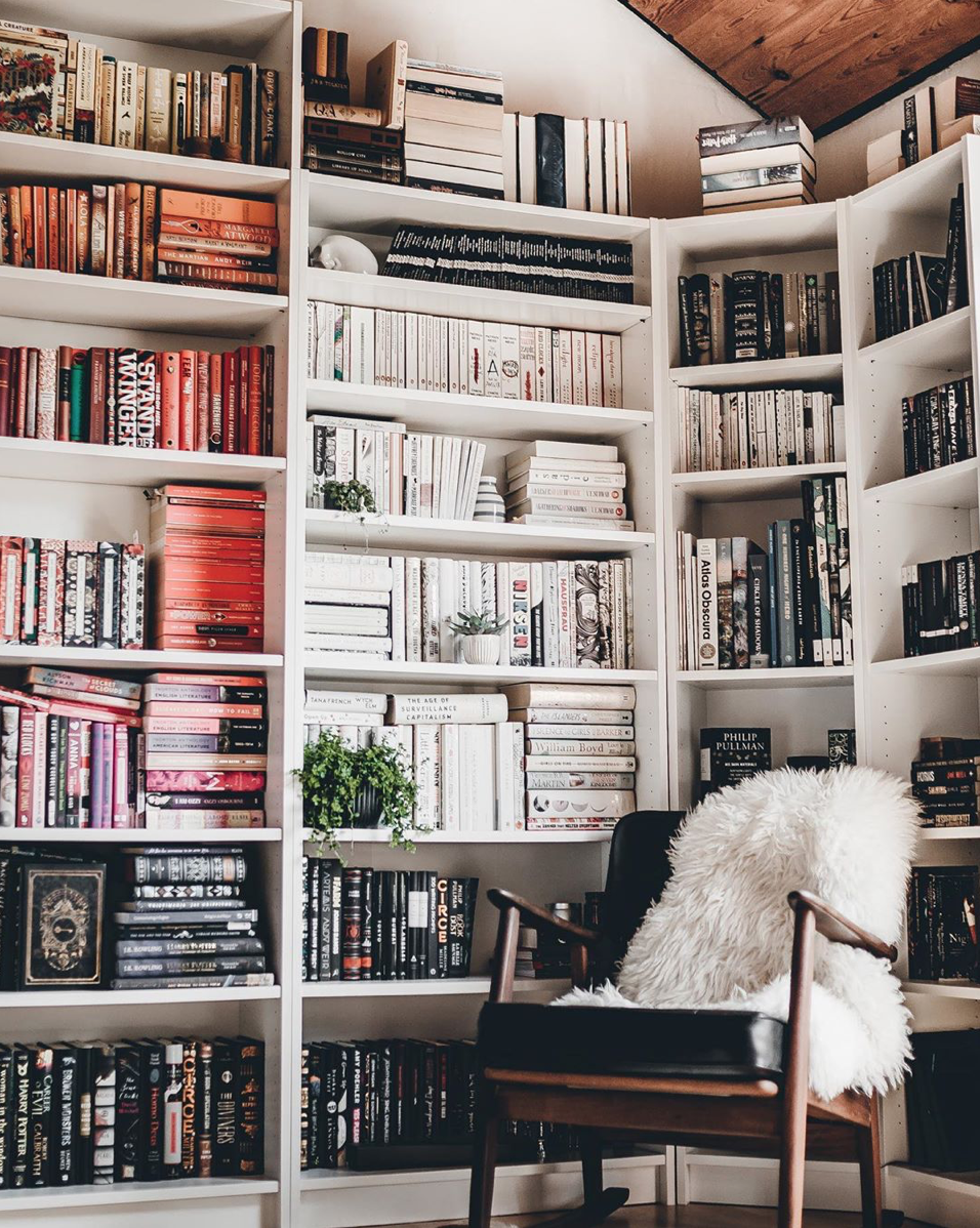 Books Sorted in Black, Pink and White via @silkreads