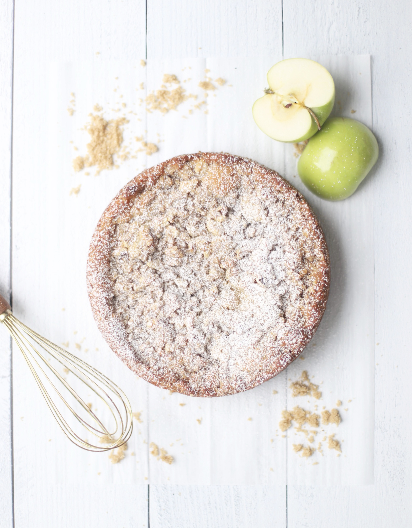 apple crumb cake topped with powdered sugar