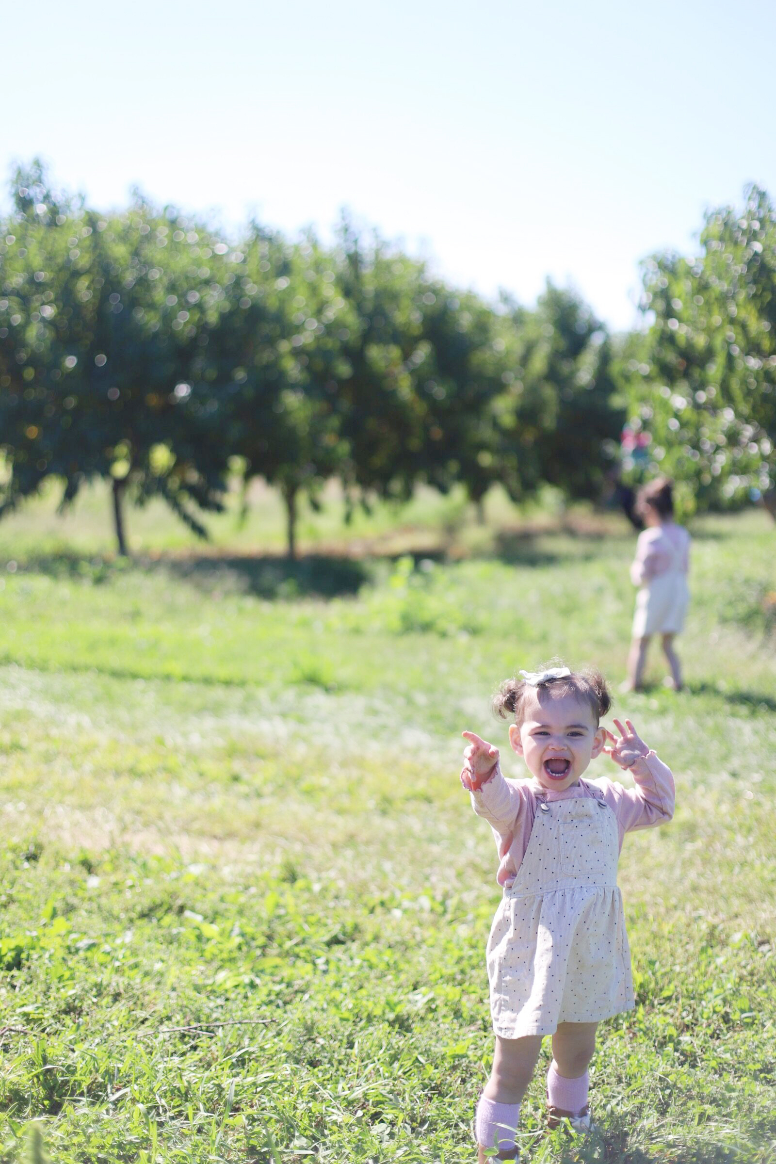 A happy little girl at Brooksby Farm in Peabody, Massachusetts // Fall Bucket List | glitterinc.com | @glitterinc