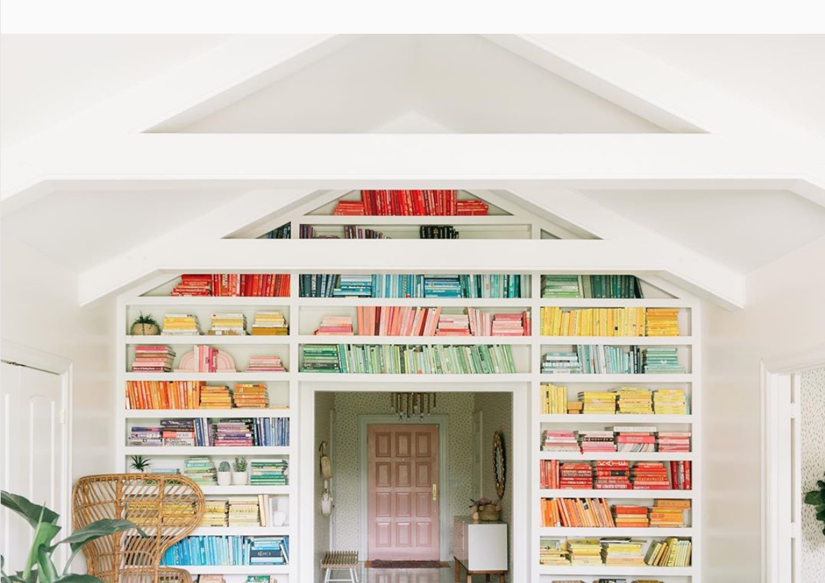 Pastel Rainbow Sorted Book Wall via @abeautifulmess