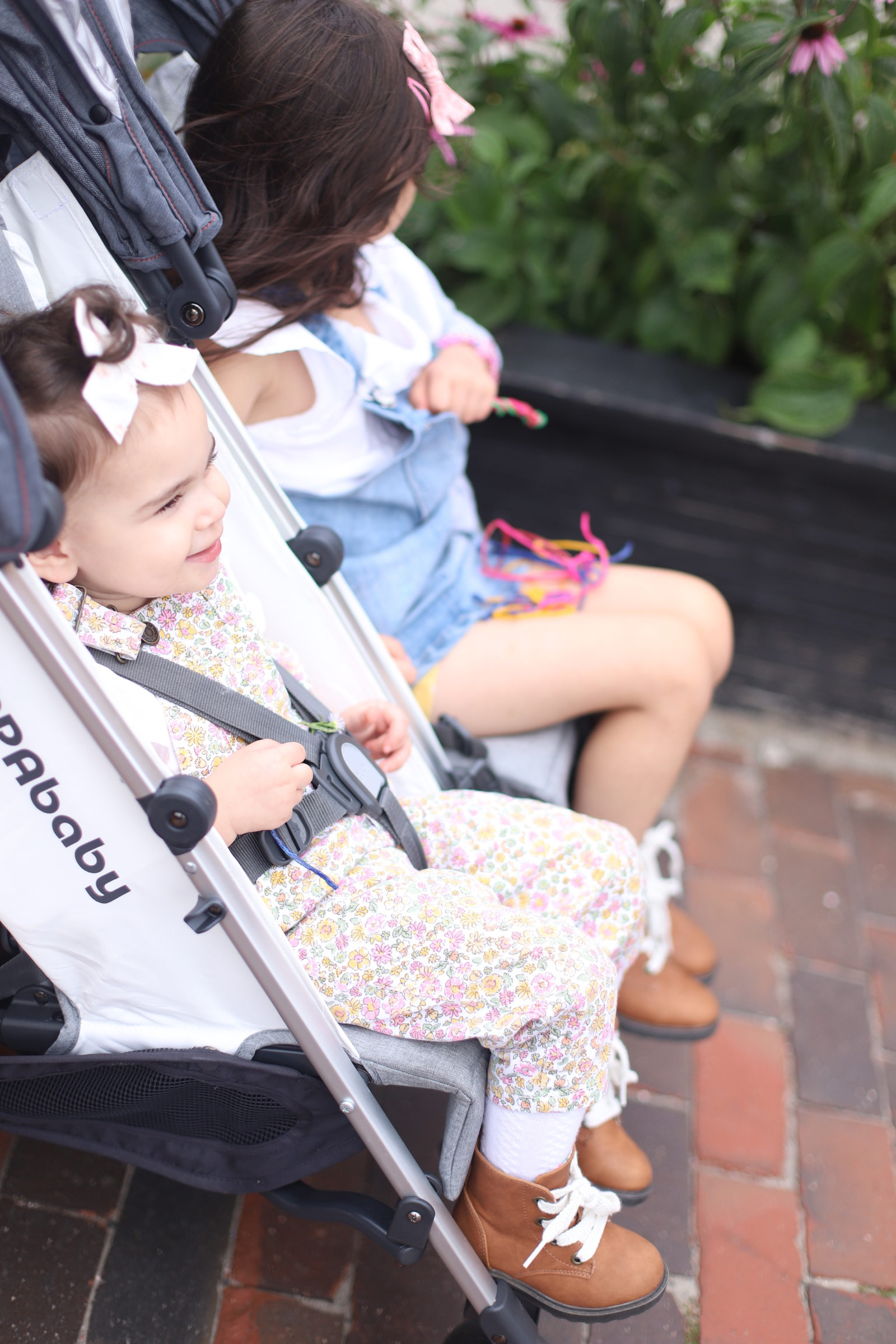 Two kids in lightweight double stroller from UPPAbaby G-LINK 2