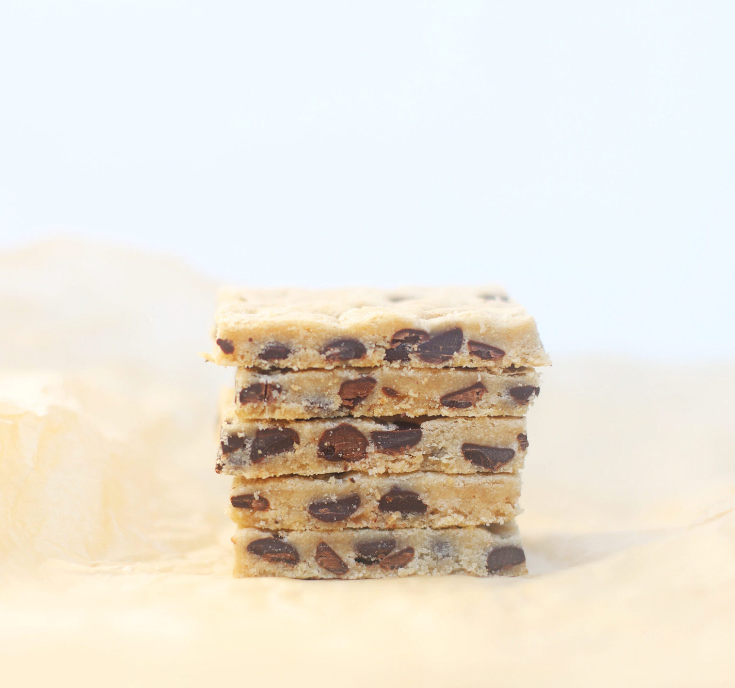 Just as decadently yummy as a classic cookie, cookie bars are simple to make and come together in a fraction of the time. And these vegan chocolate chip cookie bars in particular are moist, chewy, and a total crowd-pleaser! #recipe #cookiebars #vegancookies #vegan #dairyfree   glitterinc.com   @glitterinc