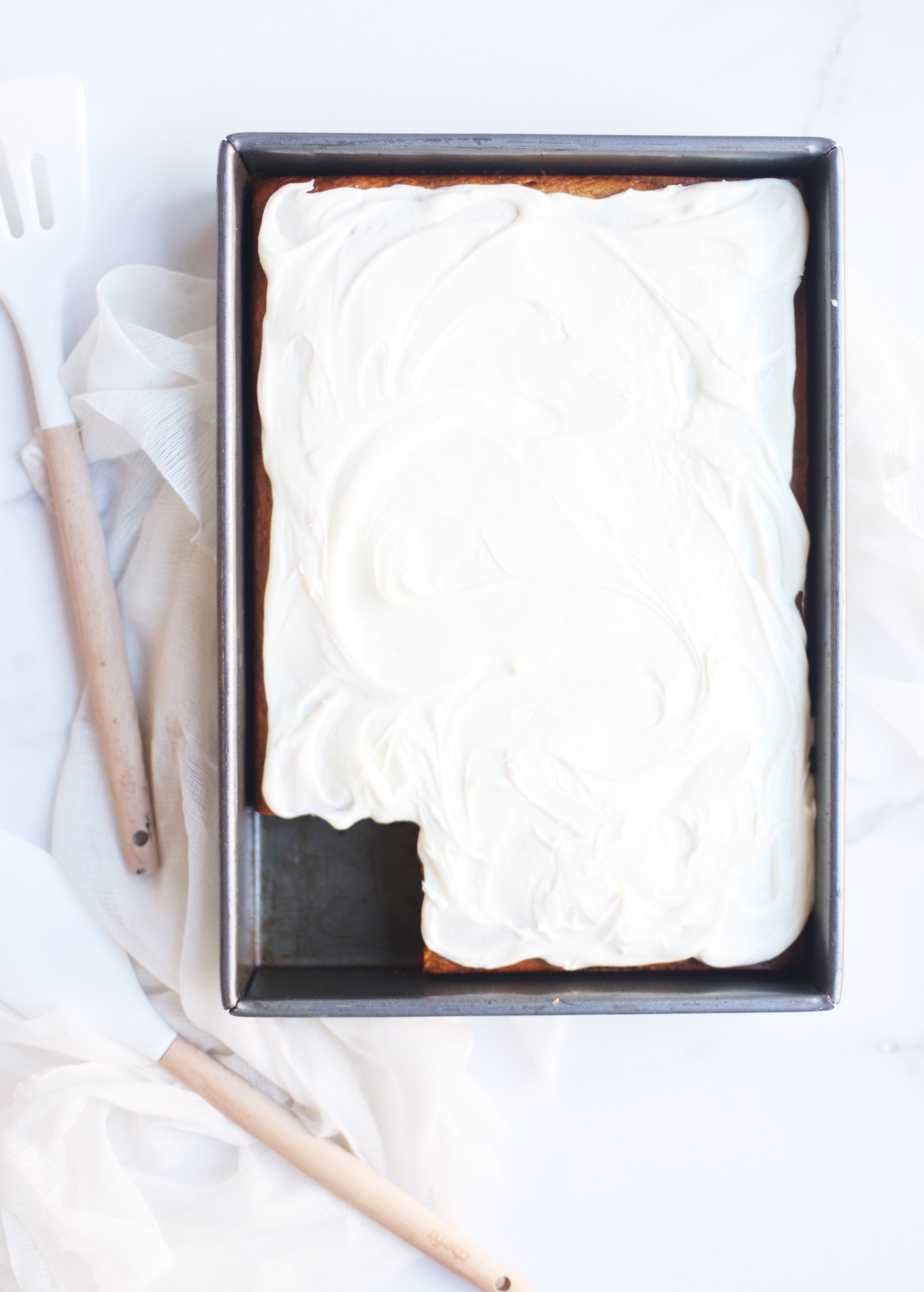 A total crowdpleaser, this gluten-free pumpkin sheet cake with cream cheese frosting is so simple to make and unbelievably yummy. And can easily be made dairy free. The end result tastes like everything good about fall! Click through for the recipe. | glitterinc.com | @glitterinc