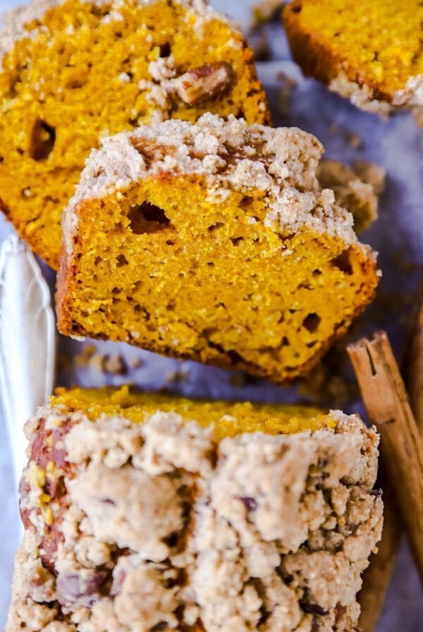 These delicious snacks, packed with the season's best fall flavors, will keep you and your family happily snacking all fall long! Click through for the recipes. | glitterinc.com | @glitterinc // Cinnamon Pecan Streusel Pumpkin Bread