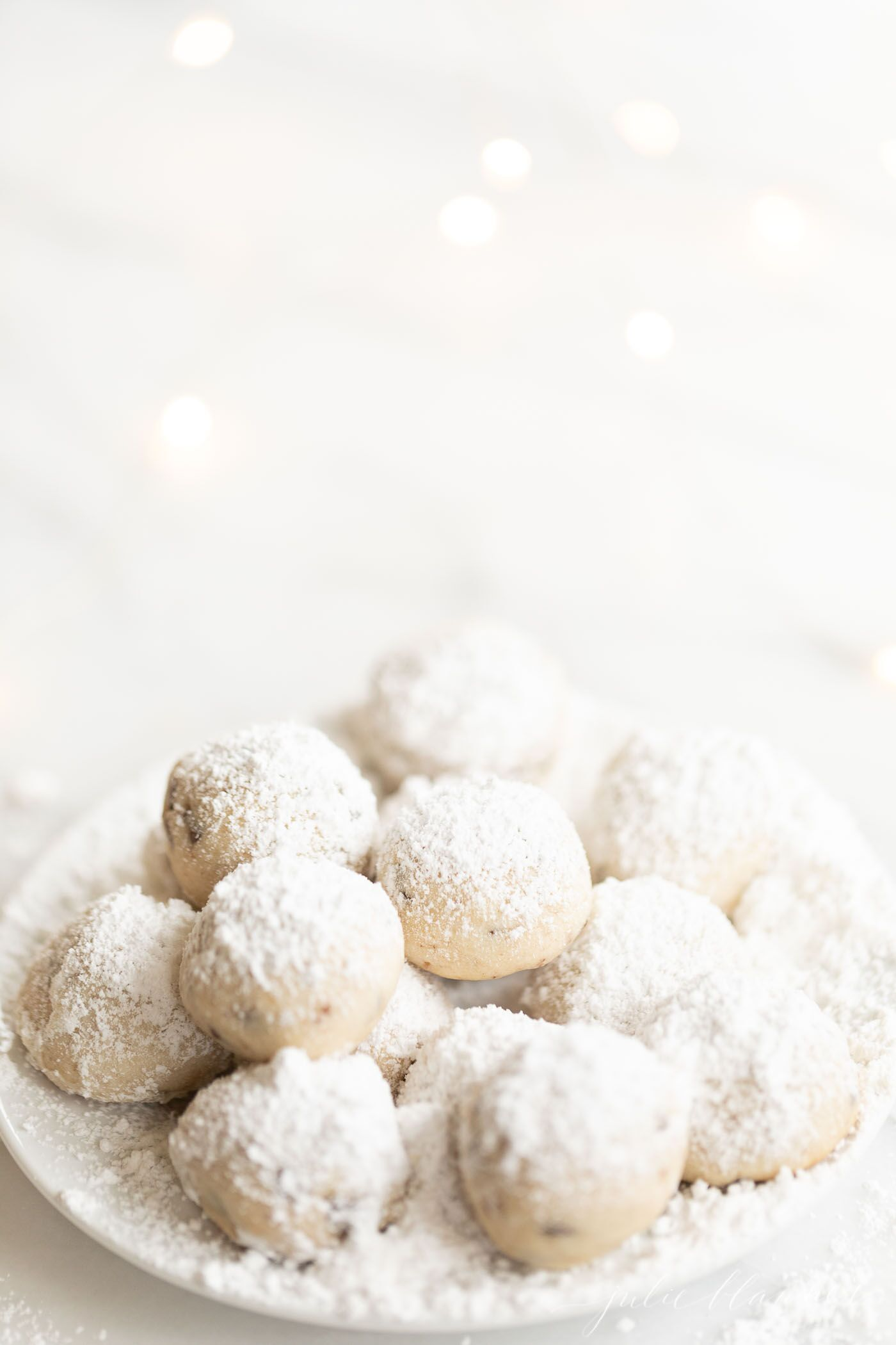 Chocolate Chip Pecan Snowball Cookies, plus how to throw a Christmas cookie exchange this holiday season! These hosting tips will help you to plan one awesome cookie swap party, including more than 40 recipes for our favorite holiday cookies ever! | glitterinc.com | @glitterinc