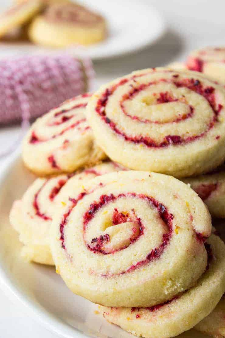 Cranberry Orange Swirl Cookies, plus how to throw a Christmas cookie exchange this holiday season! These hosting tips will help you to plan one awesome cookie swap party, including more than 40 recipes for our favorite holiday cookies ever! | glitterinc.com | @glitterinc