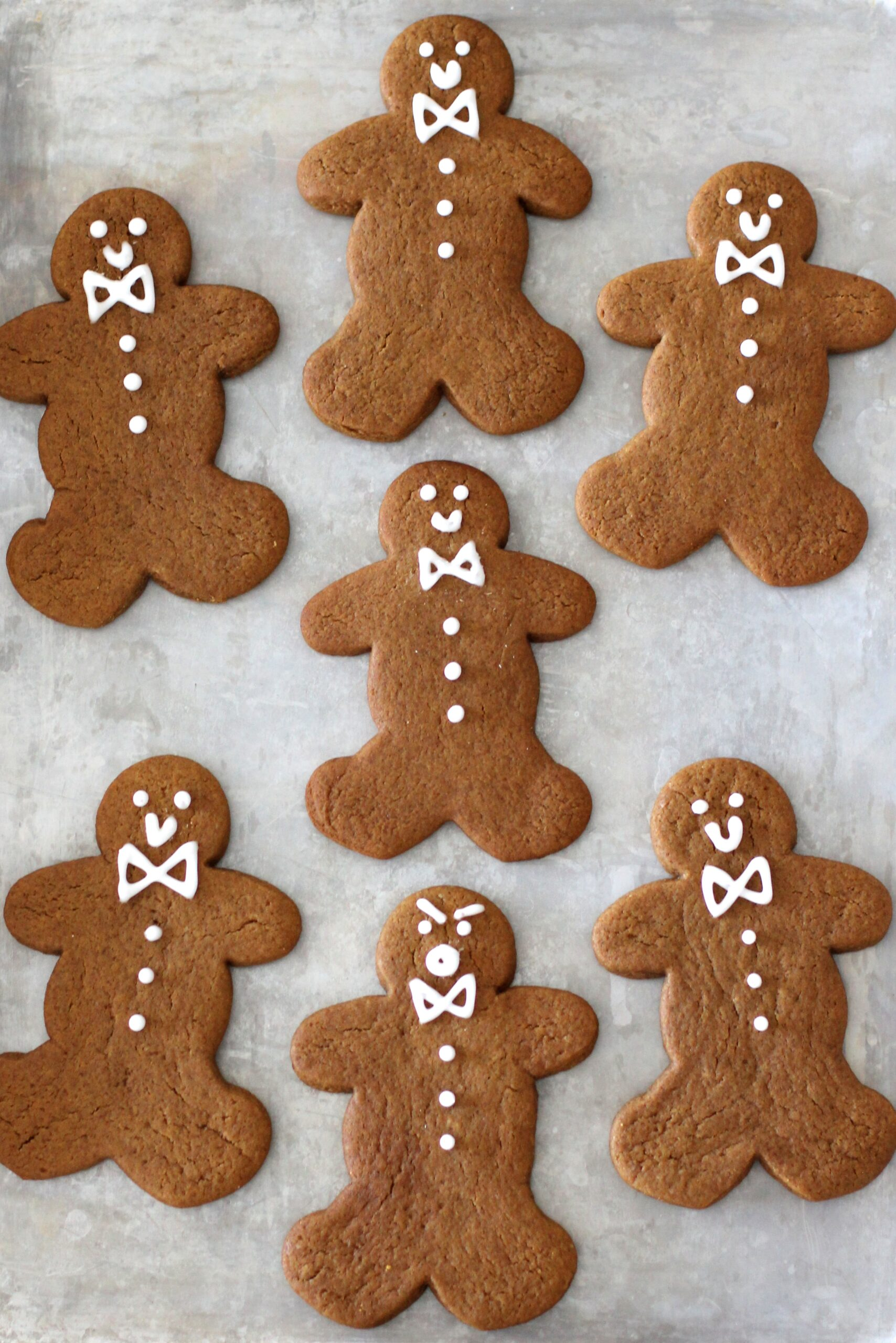 Frosted Chewy Gingerbread Cookies, plus how to throw a Christmas cookie exchange this holiday season! These hosting tips will help you to plan one awesome cookie swap party, including more than 40 recipes for our favorite holiday cookies ever! | glitterinc.com | @glitterinc