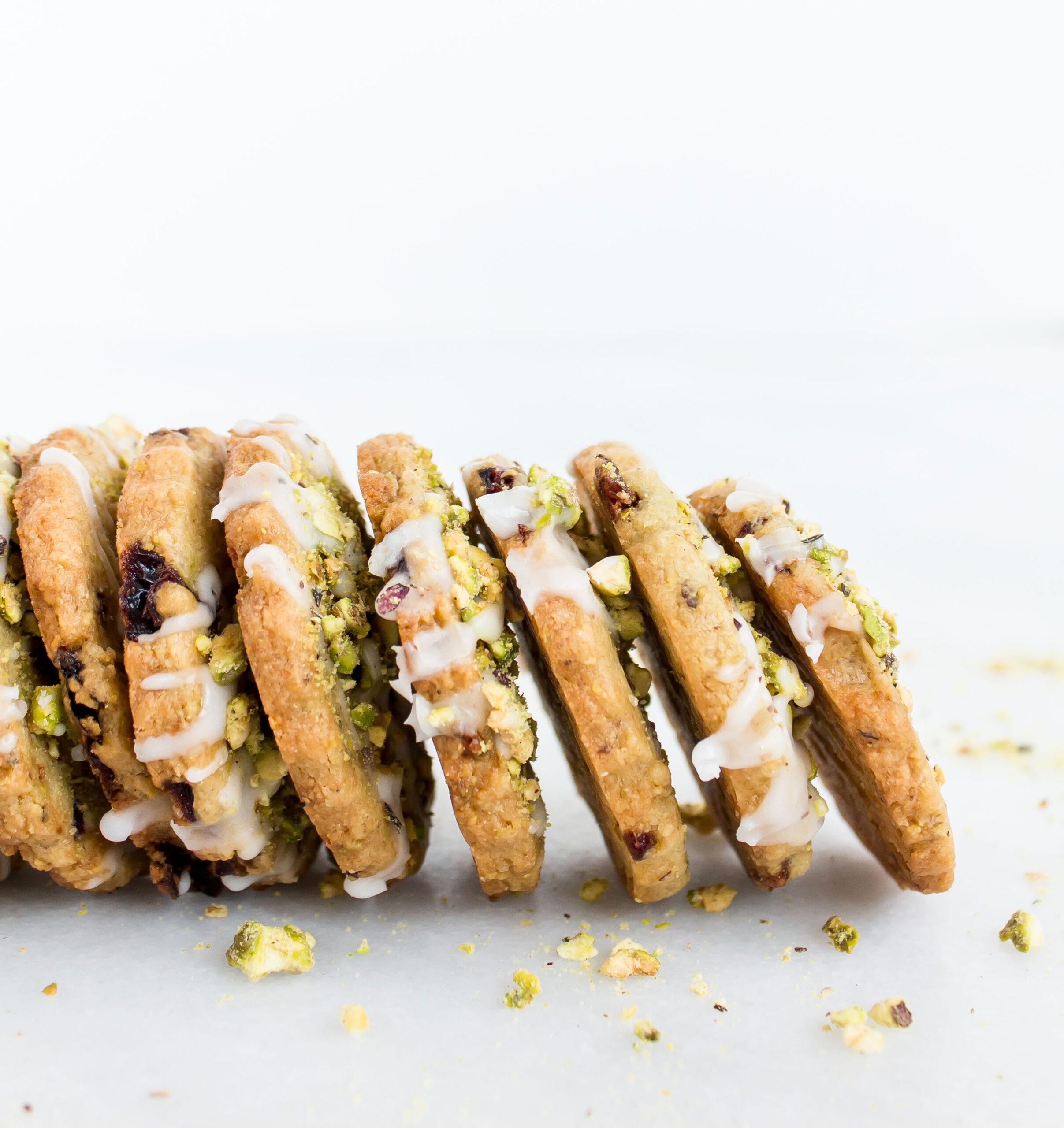 Frosted Pistachio Cranberry Shortbread Cookies | glitterinc.com | @glitterinc