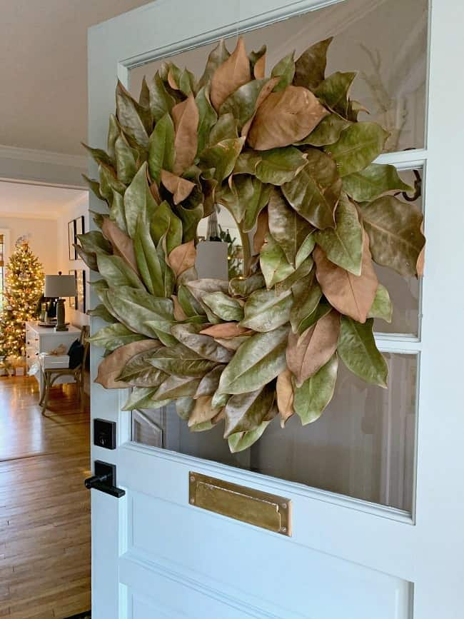 Decorating your house for Christmas? These 4 beautiful and unique Holiday home tours are sure to get you inspired this holiday season! | glitterinc.com | @glitterinc // Rustic Holiday Home Tour // Magnolia Wreath on a Farmhouse Front Door