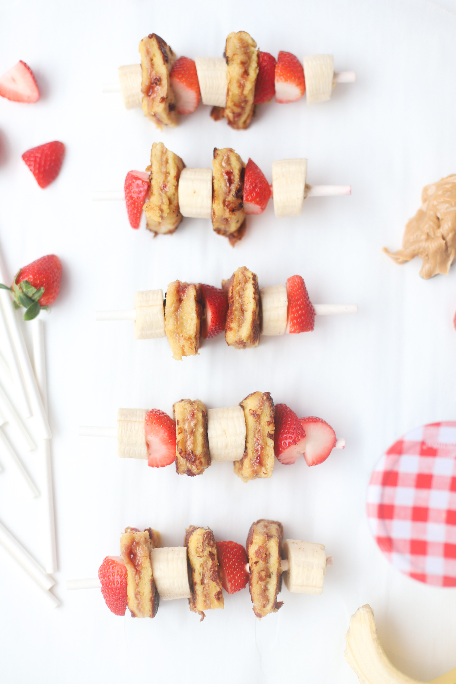 Make these adorable and decadent stuffed PB&J French Toast Kabobs for your next brunch. Peanut butter and jelly crossed with French toast never tasted so good! Click through for the recipe. | glitterinc.com | @glitterinc