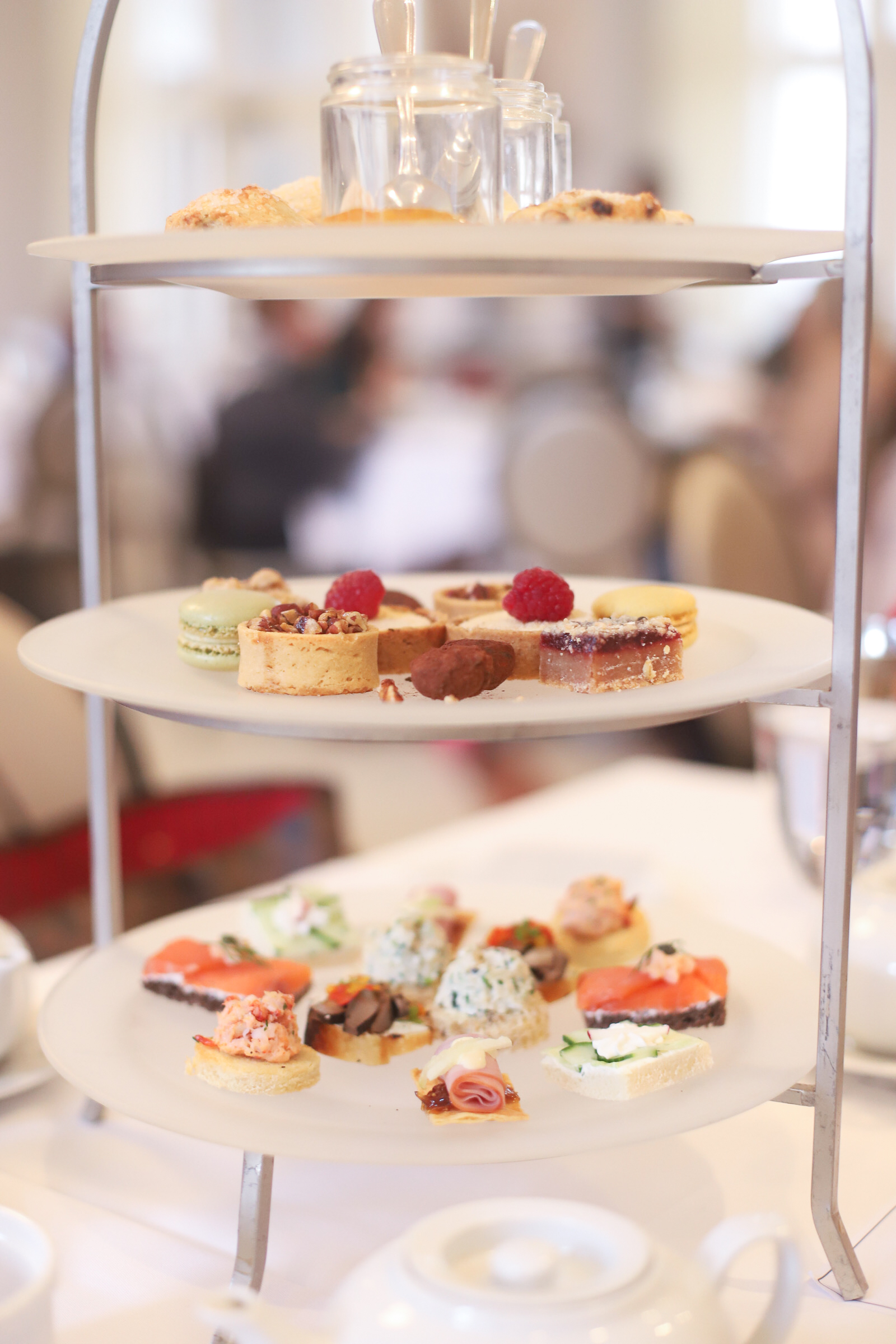 Visiting Boston? Be sure to spend an afternoon at The Courtyard Tea Room in the Boston Public Library for the yummiest, classic high tea in the city! Bonus: it's a kid-friendly afternoon tea, perfect for families. | glitterinc.com | @glitterinc
