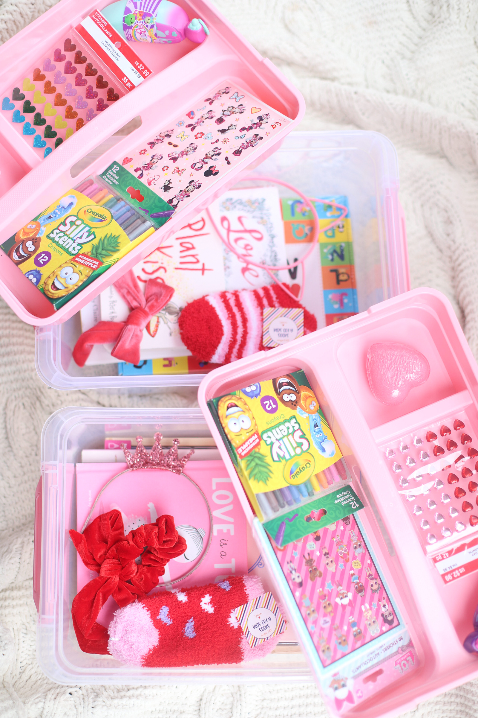 Put together the cutest DIY Valentine's Day Kids Gift Basket in a super functional storage box that your kids can use again and again for holding their crafts, school supplies, and more! Using the most amazing Latchmate Storage Boxes. | glitterinc.com | @glitterinc