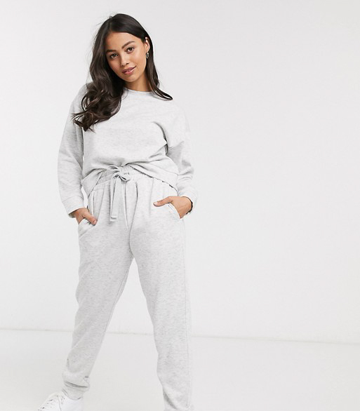 Slip into one of these adorably chic and on trend Loungewear Sets and Matching Sweatsuits, look cute as could be from the comfort of your sofa, and and stay on budget. These adorable and under $50 cozy and chic sets will get you through the season in total comfort! | glitterinc.com | @glitterinc // ASOS DESIGN Petite lounge sweat & jogger set