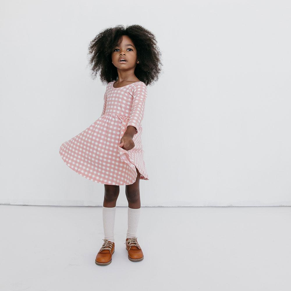 If you have a little girl who loves a great twirly dress, this post is for you! Sharing where to find the very best twirly dresses; a.k.a., skater dresses, for kids. | glitterinc.com | @glitterinc // Alice + Ames Twirly Dress for Girls